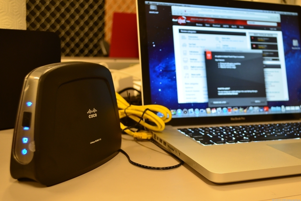 A Cisco 802.11ac media bridge is being used for a speed test.
