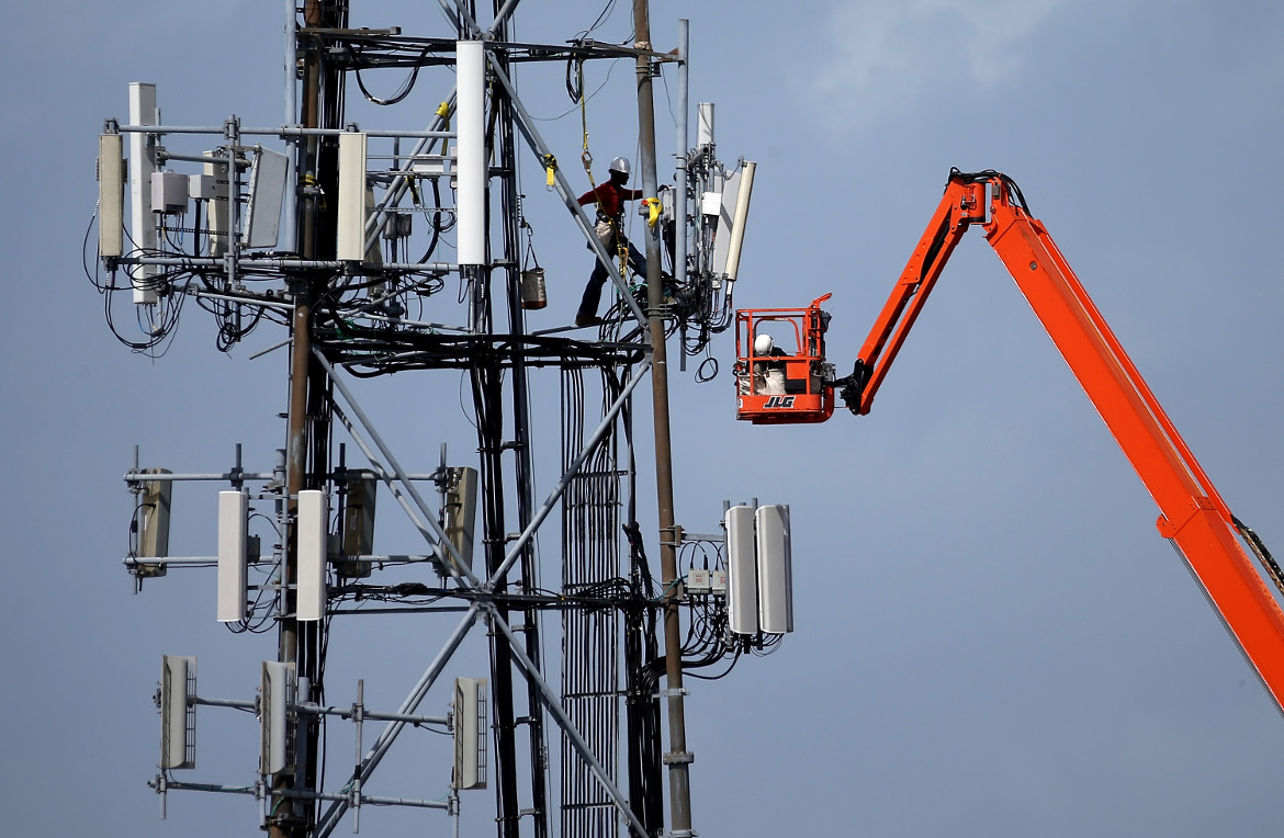 Workers on a cellular communication tower.