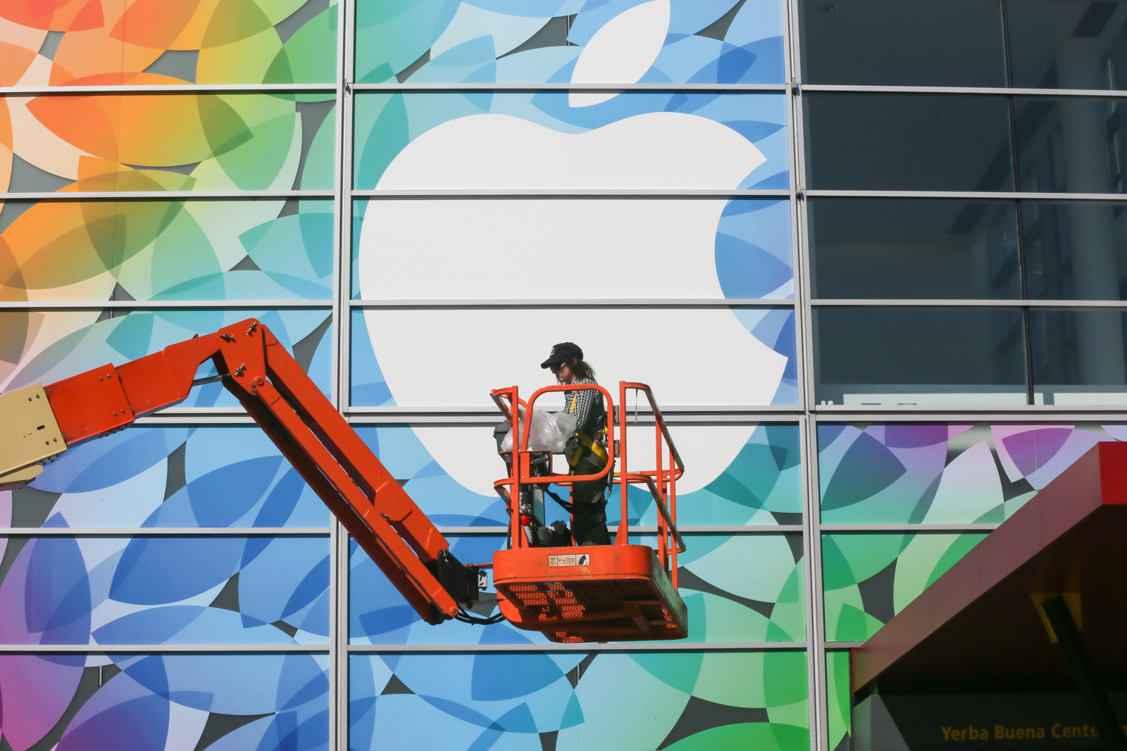Workers decorating Yerba Buena Center for the Arts Theater in San Francisco for next week's Apple event.