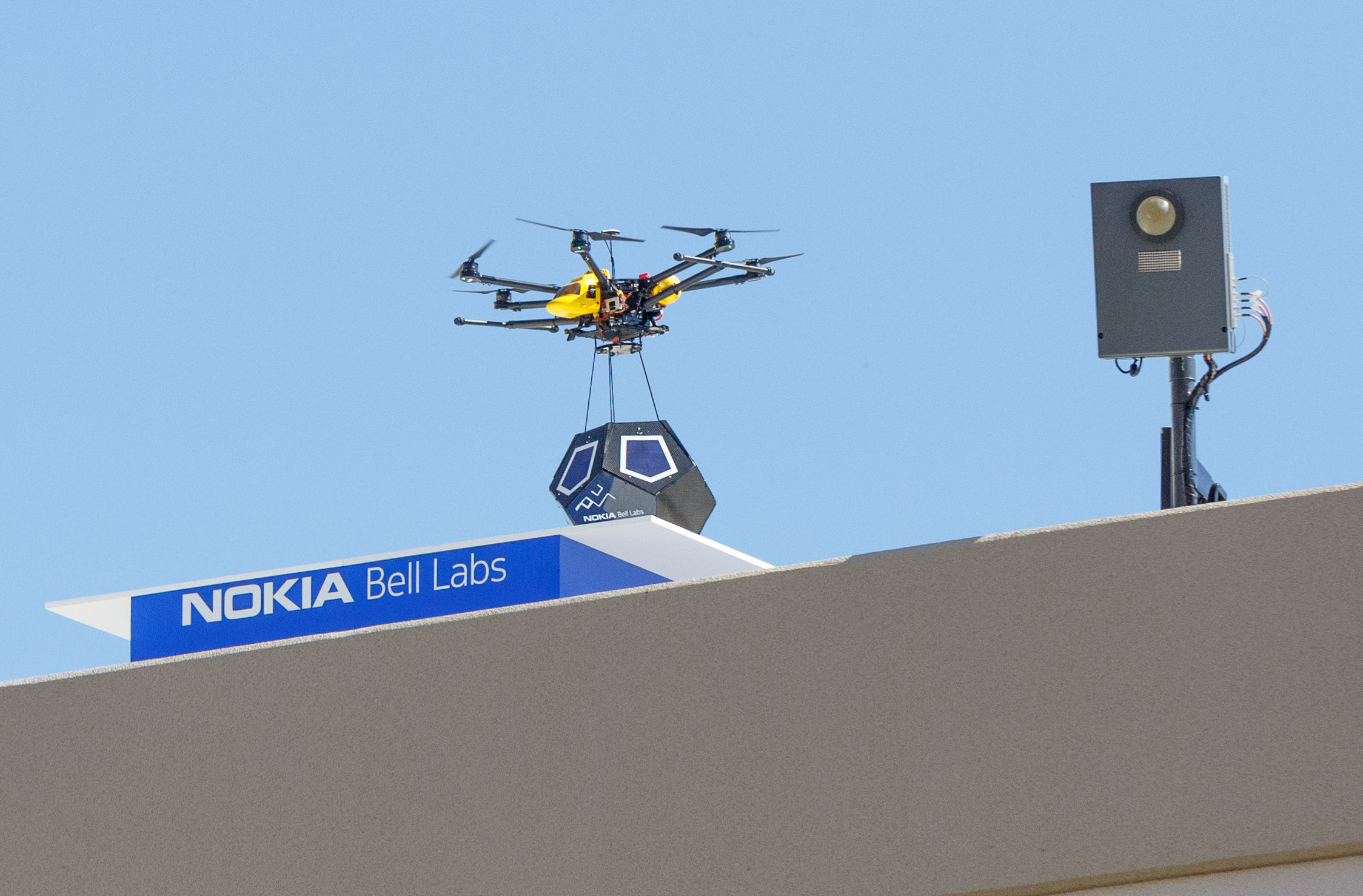 A drone lands portableA drone lands a portable, solar-powered, short-range high-speed network unit called a Future Cell on a roof near Nokia Bell Labs in Sunnyvale, California., solar-powered, short-range high-speed network unit called a Future Cell on a roof near Nokia Bell Labs in Sunnyvale, California.