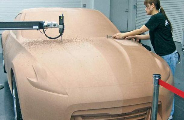 Designers work on a clay model of the Nissan Z