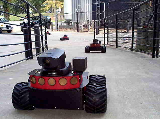 Pioneer robots in multi-robot teams used in previous research for a Defense Advanced Research Projects Agency project.