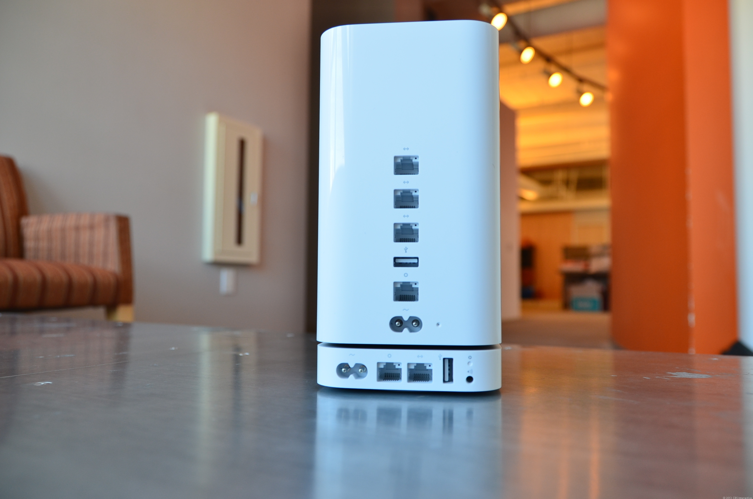 The new AirPort Extreme Base Station has the same footprint as the AirPort Express (bottom), but is much taller. Note the AirPlay audio port on the AirPort Express that the AirPort Extreme doesn't have.