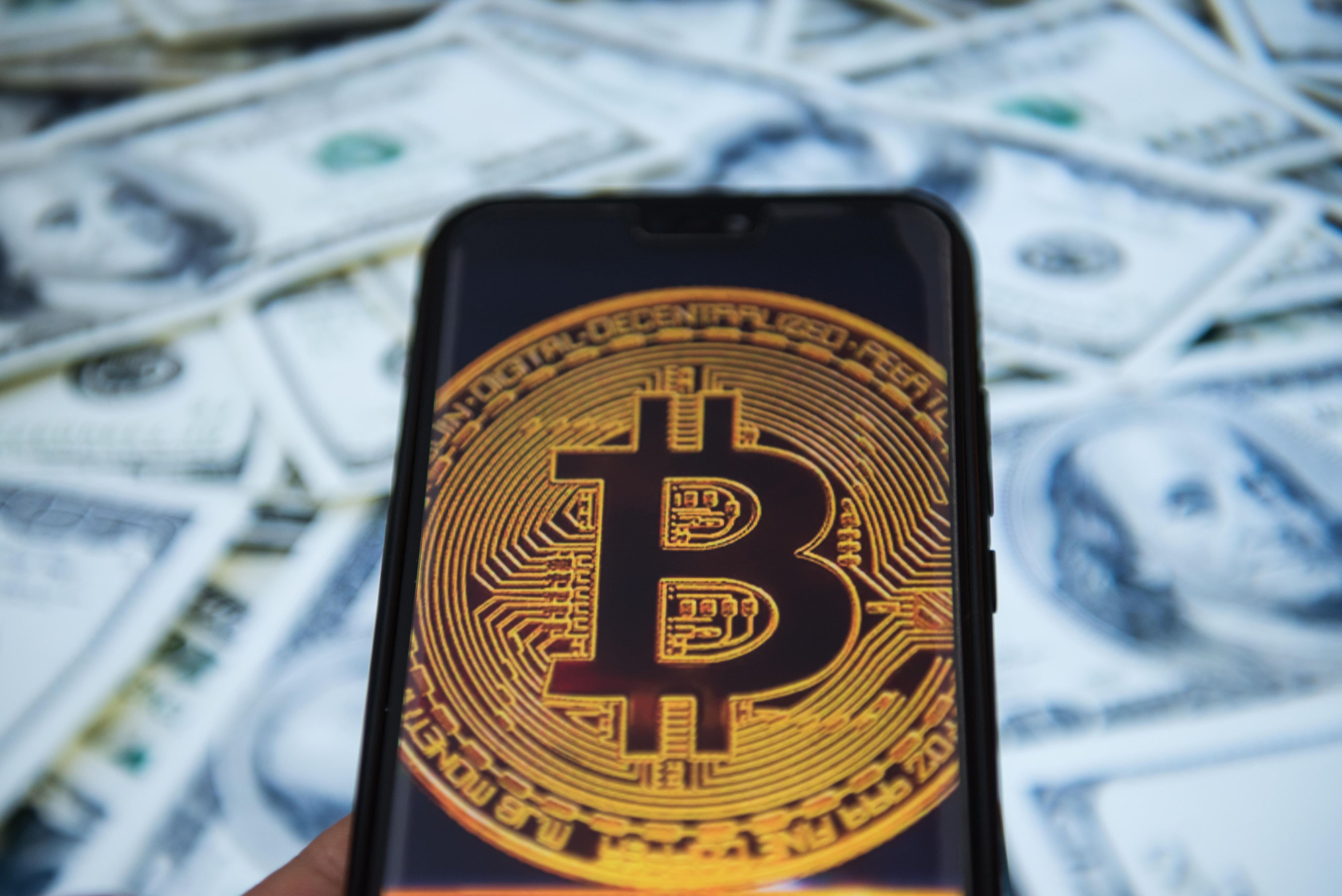 Bitcoin logo is seen on an android mobile phone