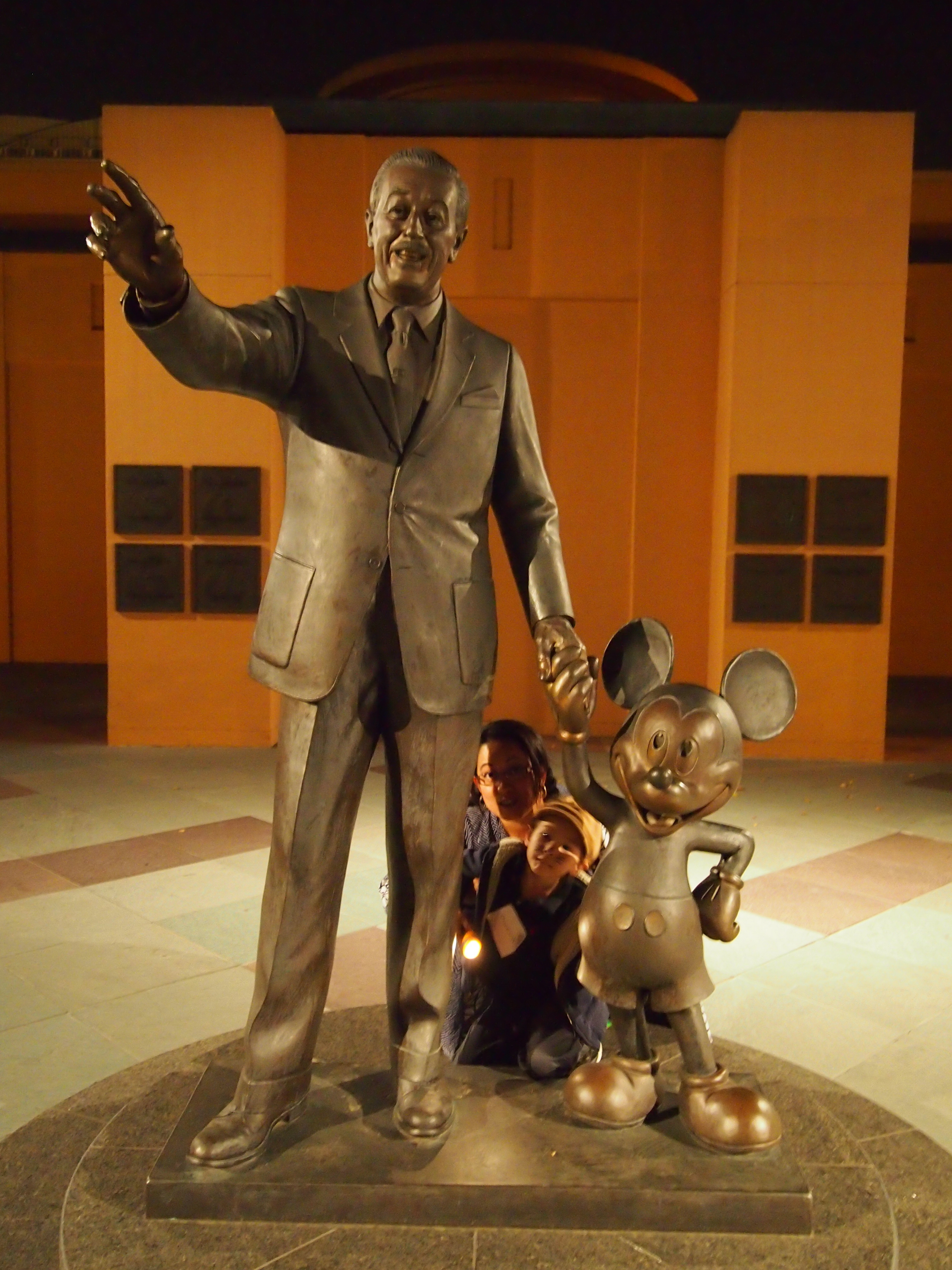 Fans pose with Walt and Mickey