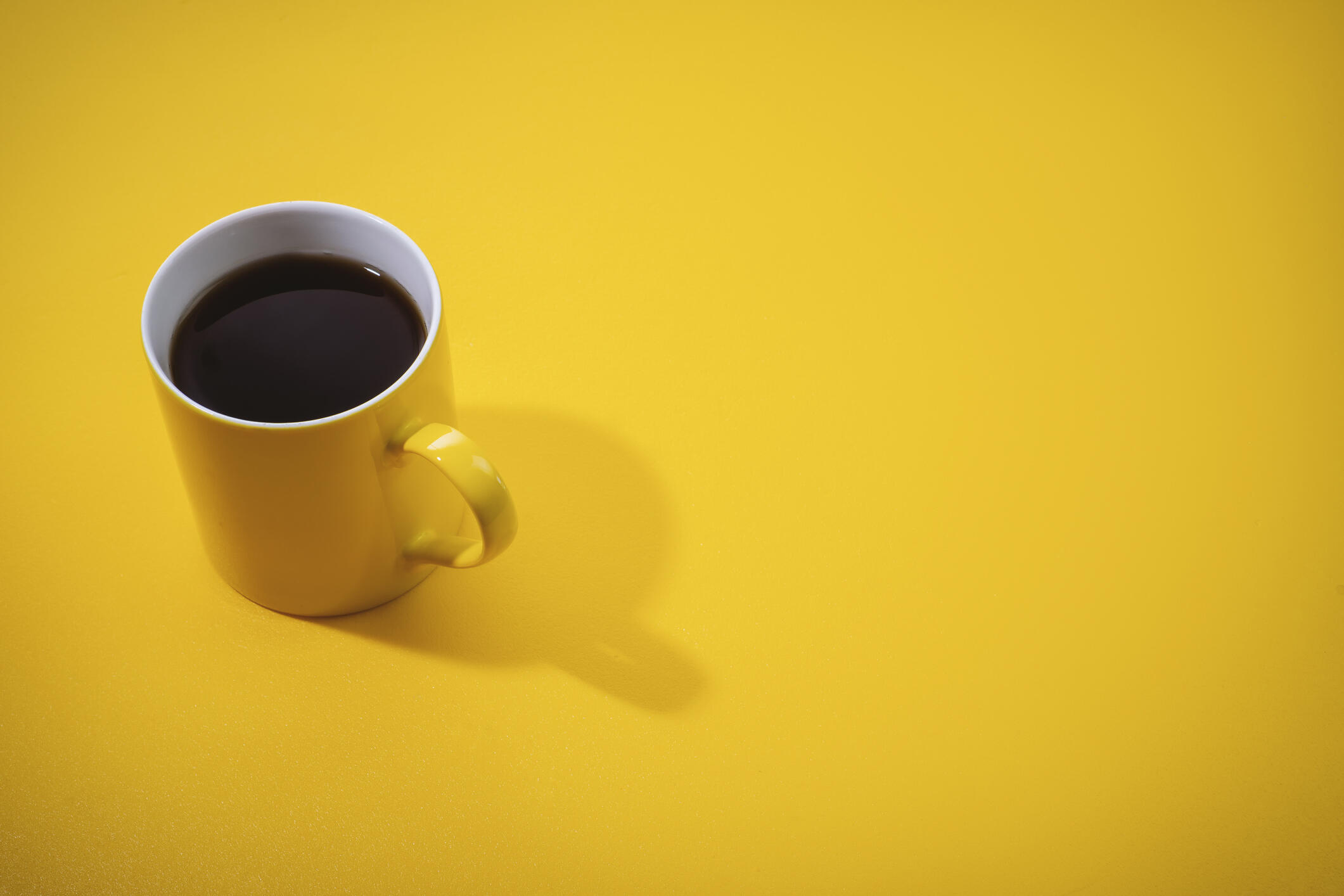 cup of coffee on a yellow background