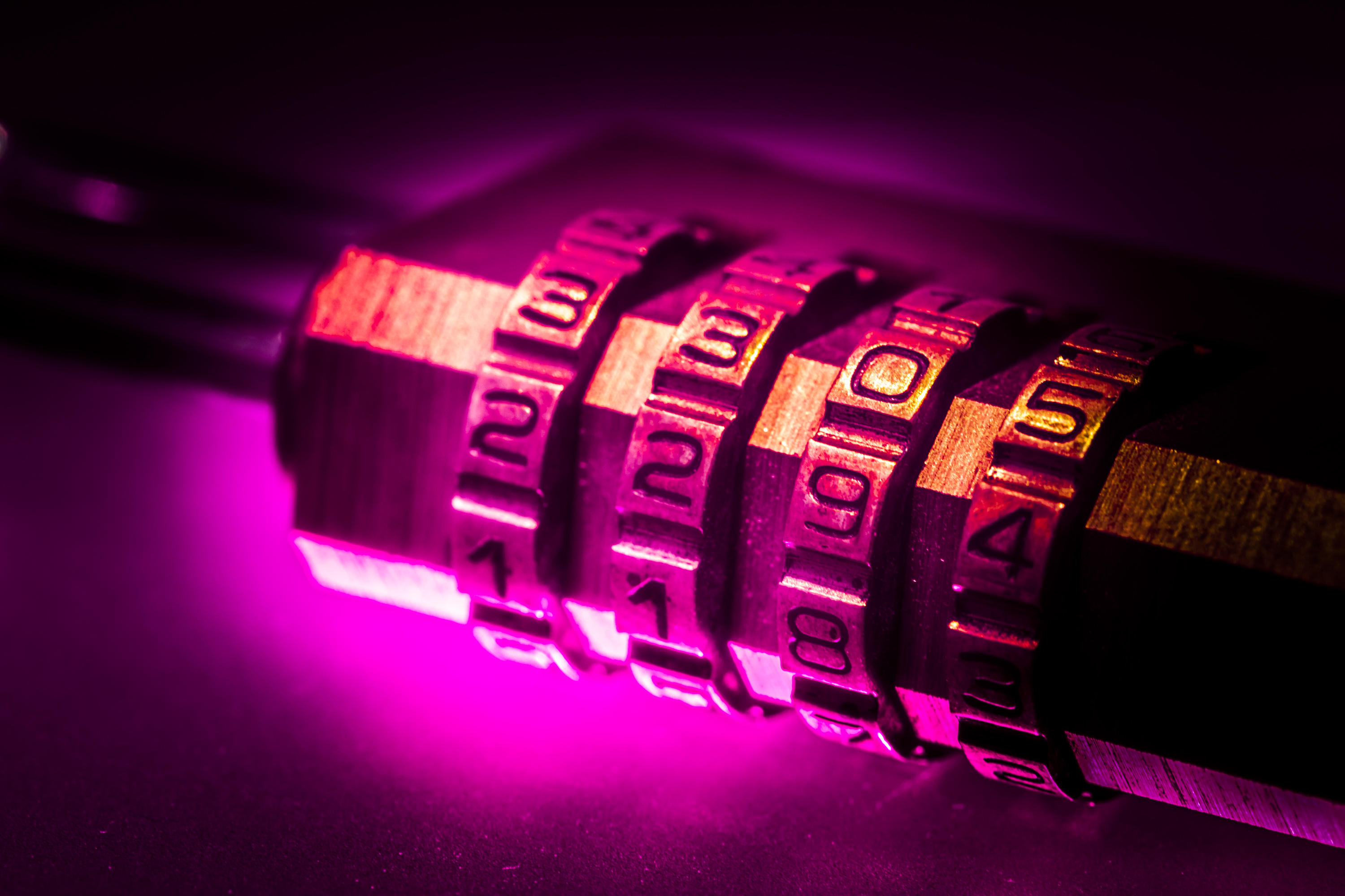Picture of a combination lock bathed in a purple glow