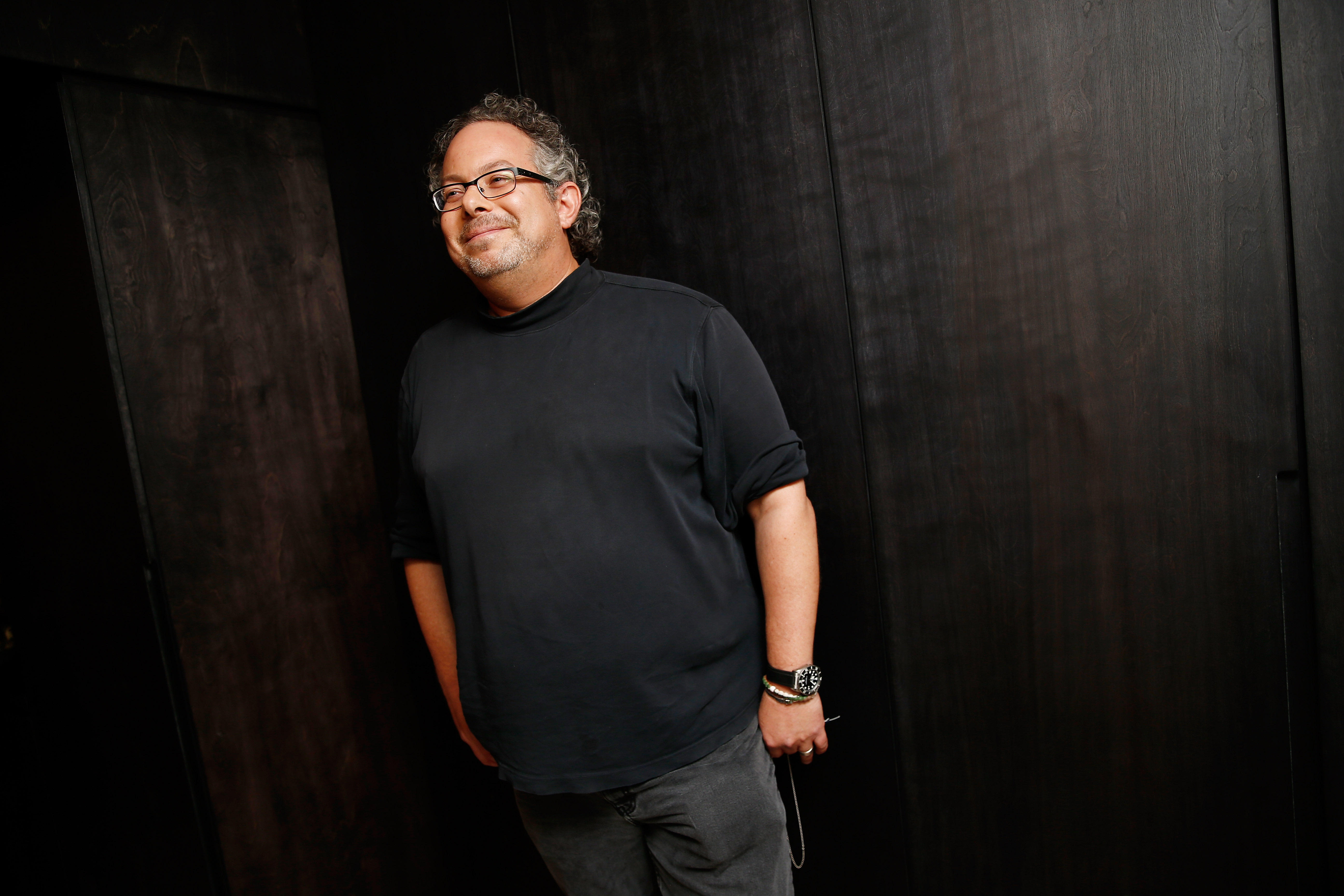 Magic Leap founder stands and smiles off camera