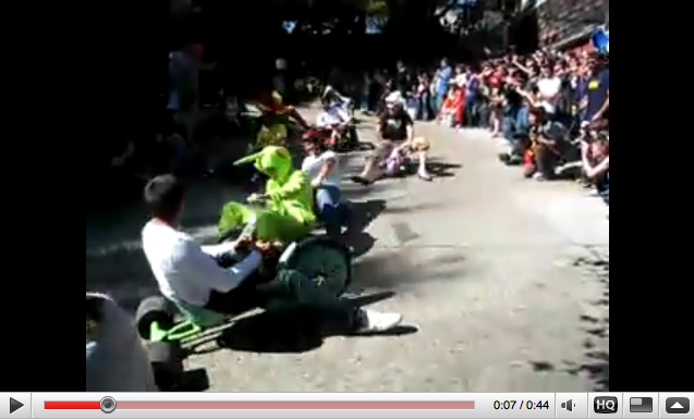 Sharp curves cause riders to spin out during the ninth annual Bring Your Own Big Wheel Race in San Francisco.