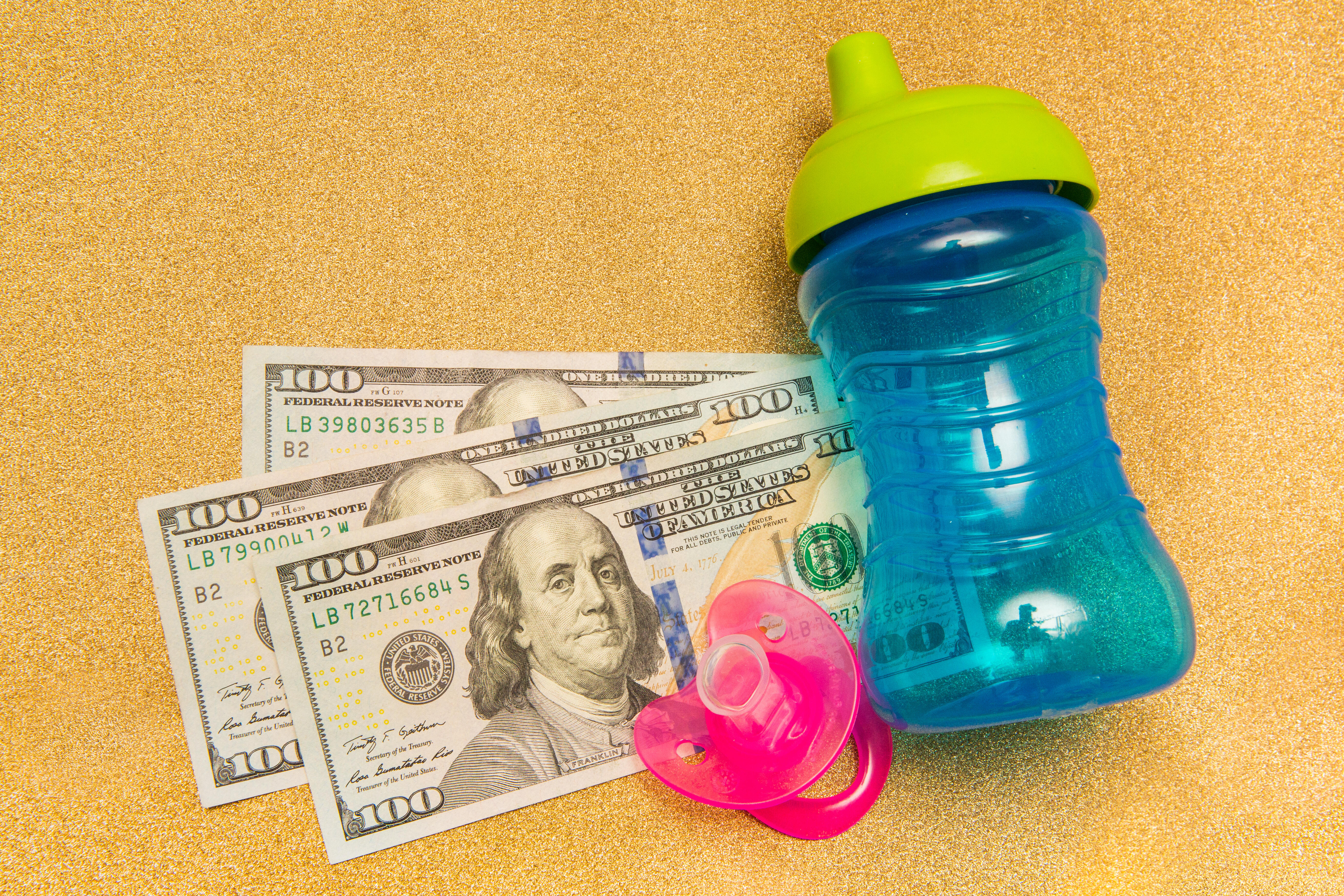 009-cash-stimulus-child-tax-credit-3600-calculator-cnet-2021-2020-federal-government-money-baby-family-pacifier-sippy