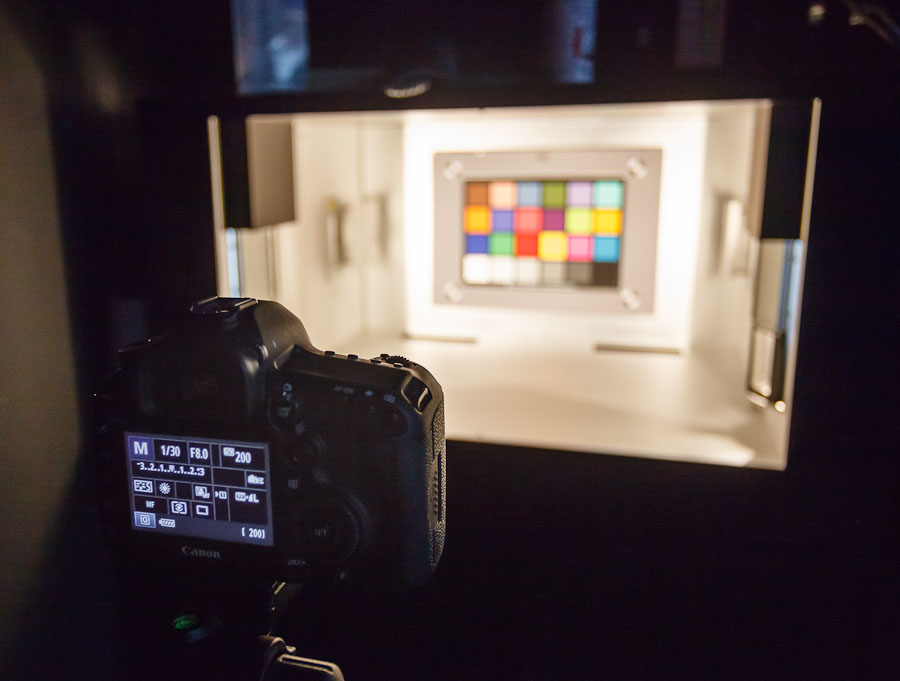 A Canon EOS 5D Mark III stands before a chart that features one of the few splashes of color in this DxO Labs testing facility.