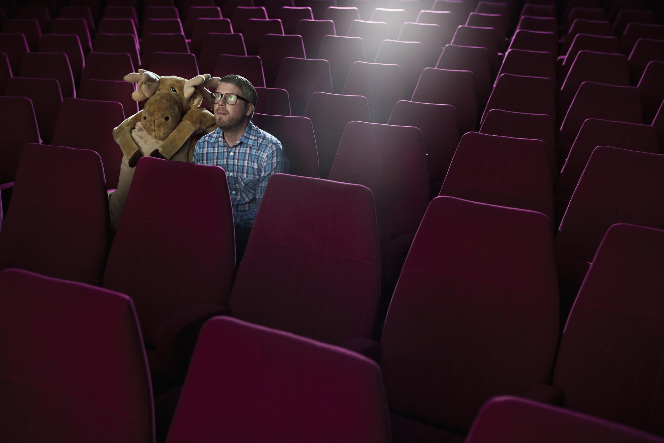 Man on a date at the movies, with a moose