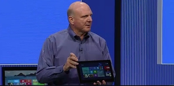 Steve Ballmer flourishes a Lenovo ThinkPad Helix hybrid tablet-laptop at the Build Conference Wednesday. He mocked the dedicated tablet as unusable and/or inefficient.