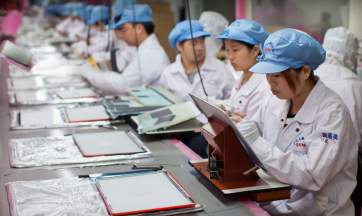 Workers at an Apple supplier facility in Shanghai.