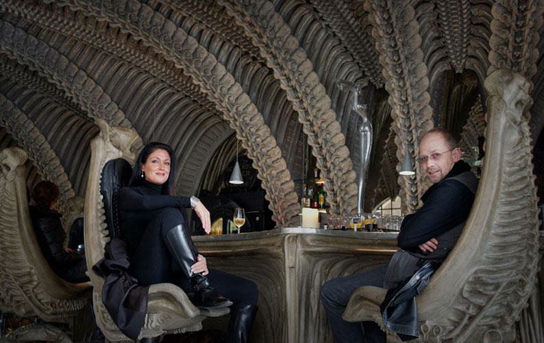 Watch out for face-huggers! Andy Davies and his wife Amy sit inside the Giger Bar in Gruyeres, Switzerland.