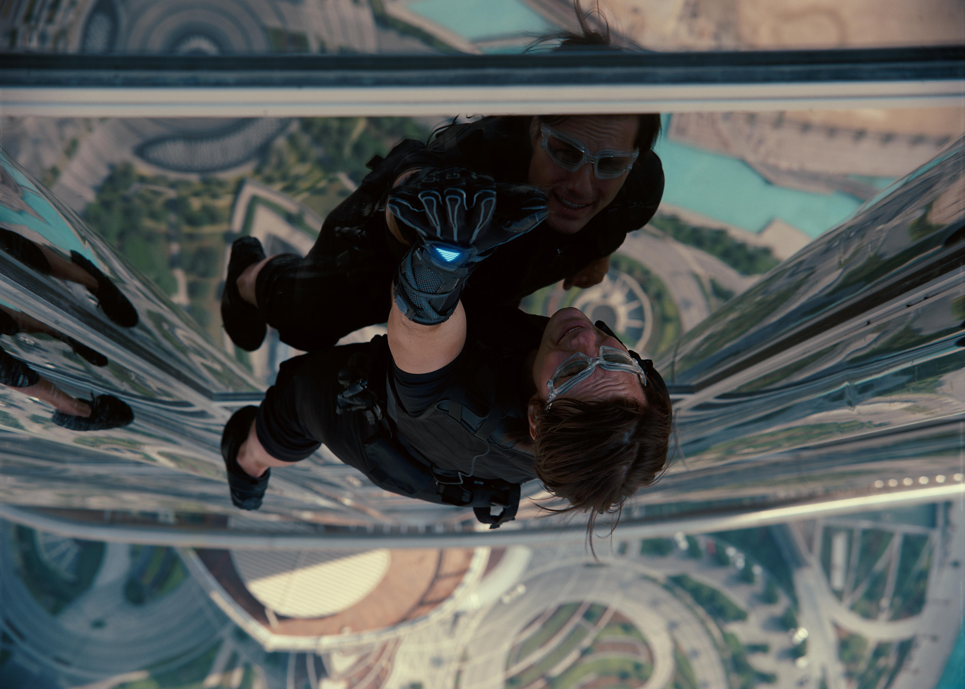 Ethan Hunt climbs the Burj Khalifa in Mission: Impossible -- Ghost Protocol, one of the series' wild stunts that showcases a cool gadget.