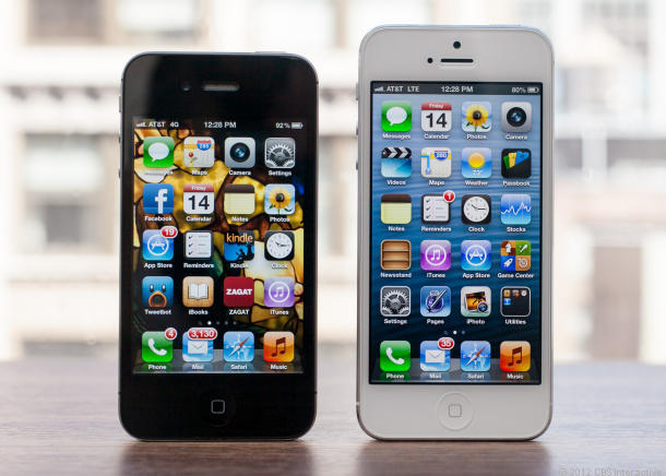 Apple's iPhone 5 (right), alongside the iPhone 4S.