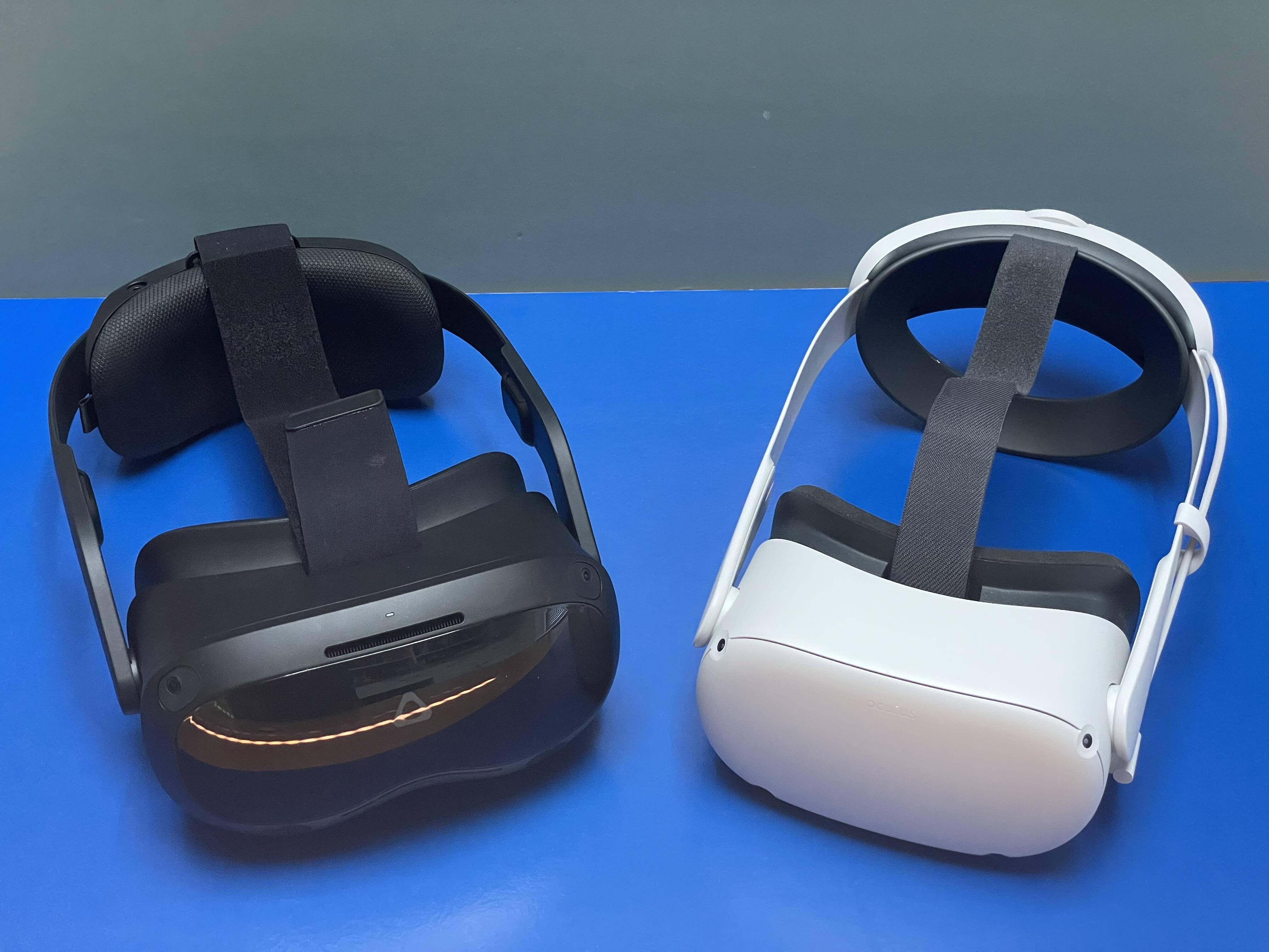 <p>The HTC Vive Focus 3 (left) next to the Oculus Quest 2 (right) with its battery strap: similar sizes, similar processors, but the Focus 3 ramps up display and features.</p>