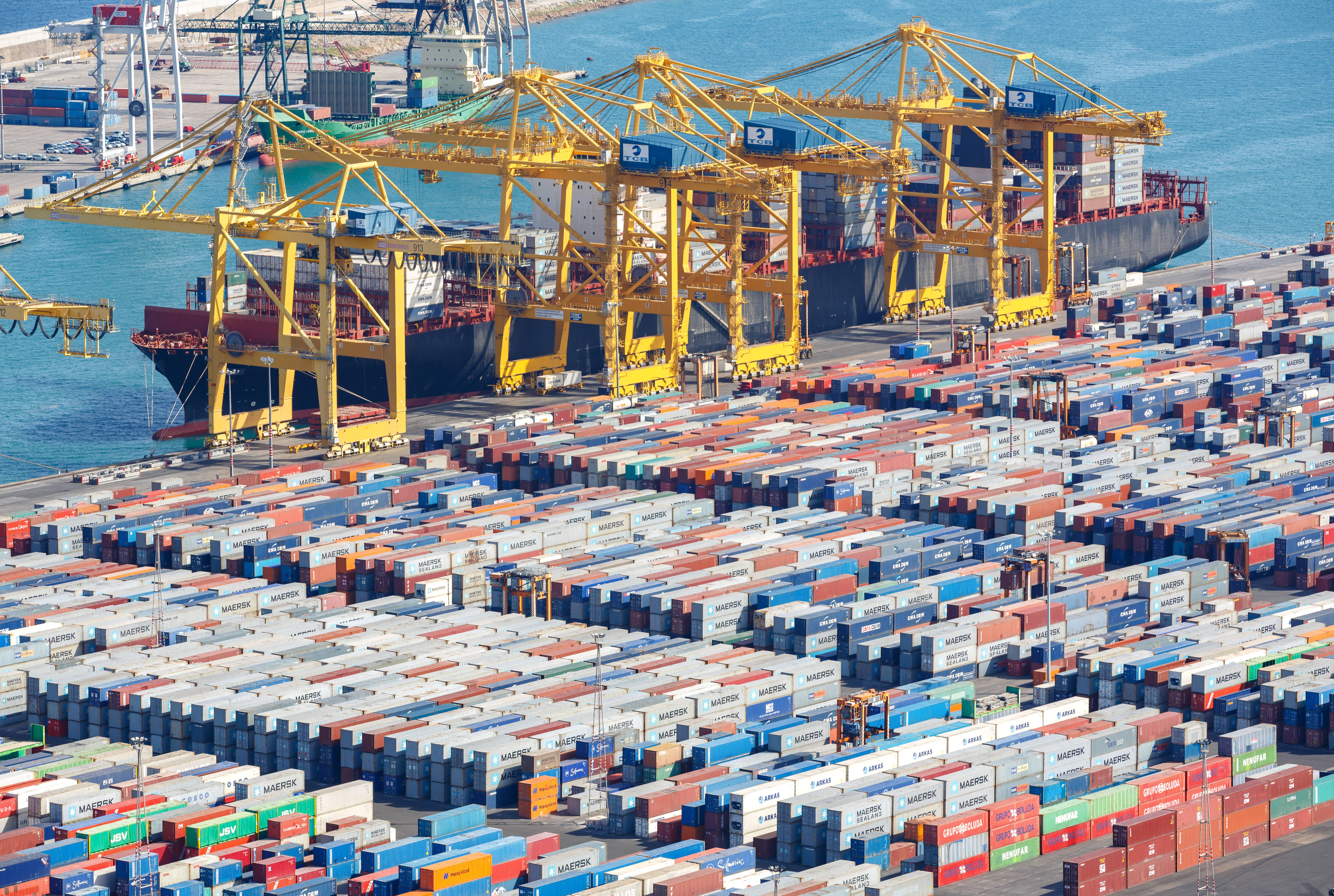 A colossal amount of cargo goes through the world's ports, like Barcelona's here in Spain, sent by standard-sized containers loaded on and off ships, trucks and trains. IBM and allies say their TradeLens blockchain-based network streamlines the paperwork.