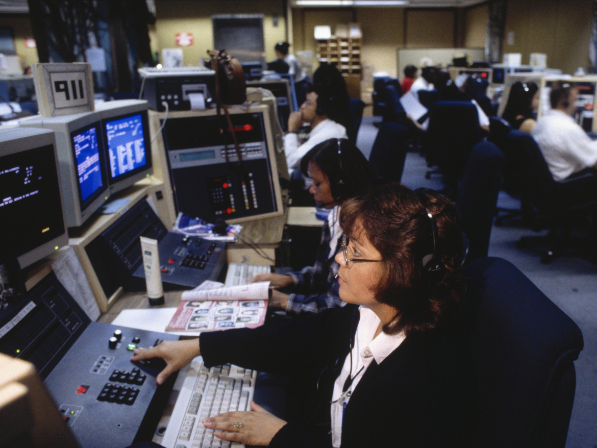 Workers at a 911 call center in Los Angeles. An emergency call center in Dallas is experiencing serious problems.