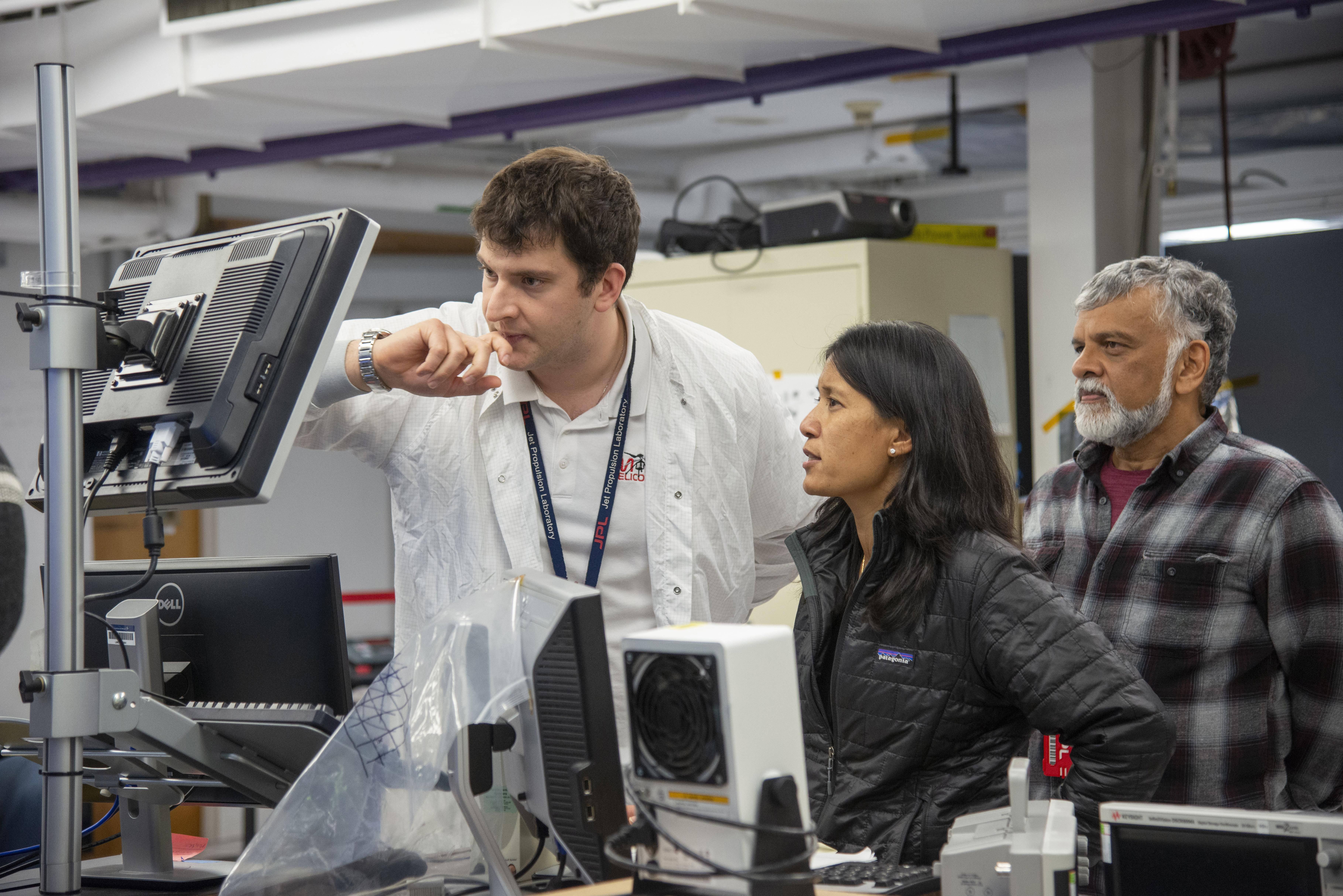 MiMi Aung, project leader of NASA's Mars Ingenuity Helicopter Project, observes a flight test with JPL engineers Teddy Tzanetos (left) and Bob Balaram.   NASA/JPL-Caltech
