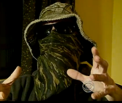 """""""Commander X"""" talked to CBS News this summer on camera, but is the man behind the mask Chris Doyon?"""