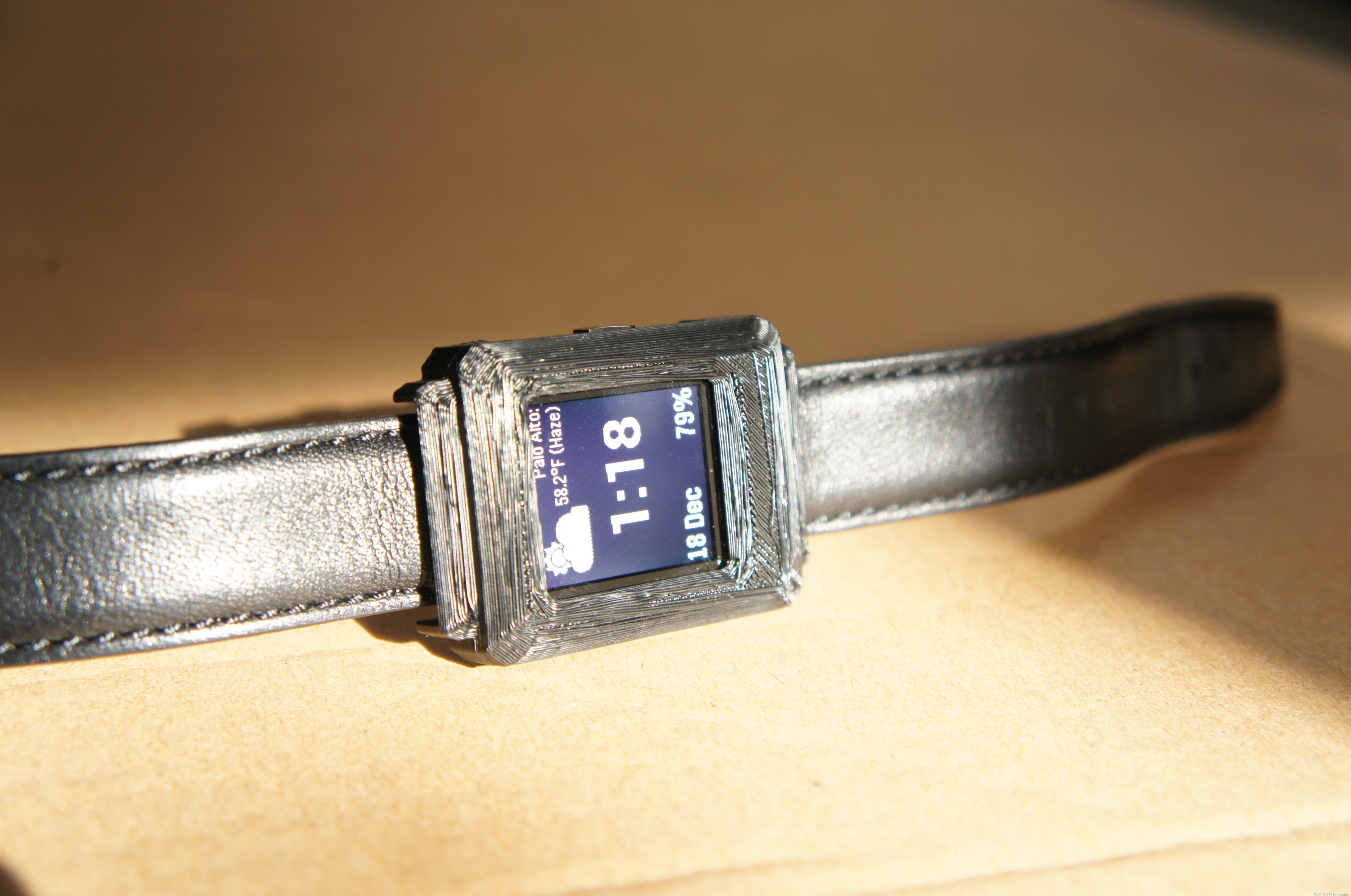 A Pebble Steel hiding in a 3D-printed case, used for testing in public.