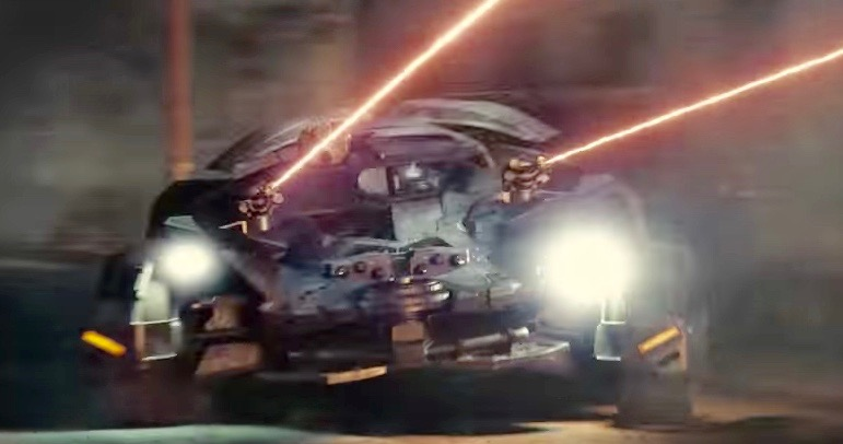The Batmobile shooting lasers