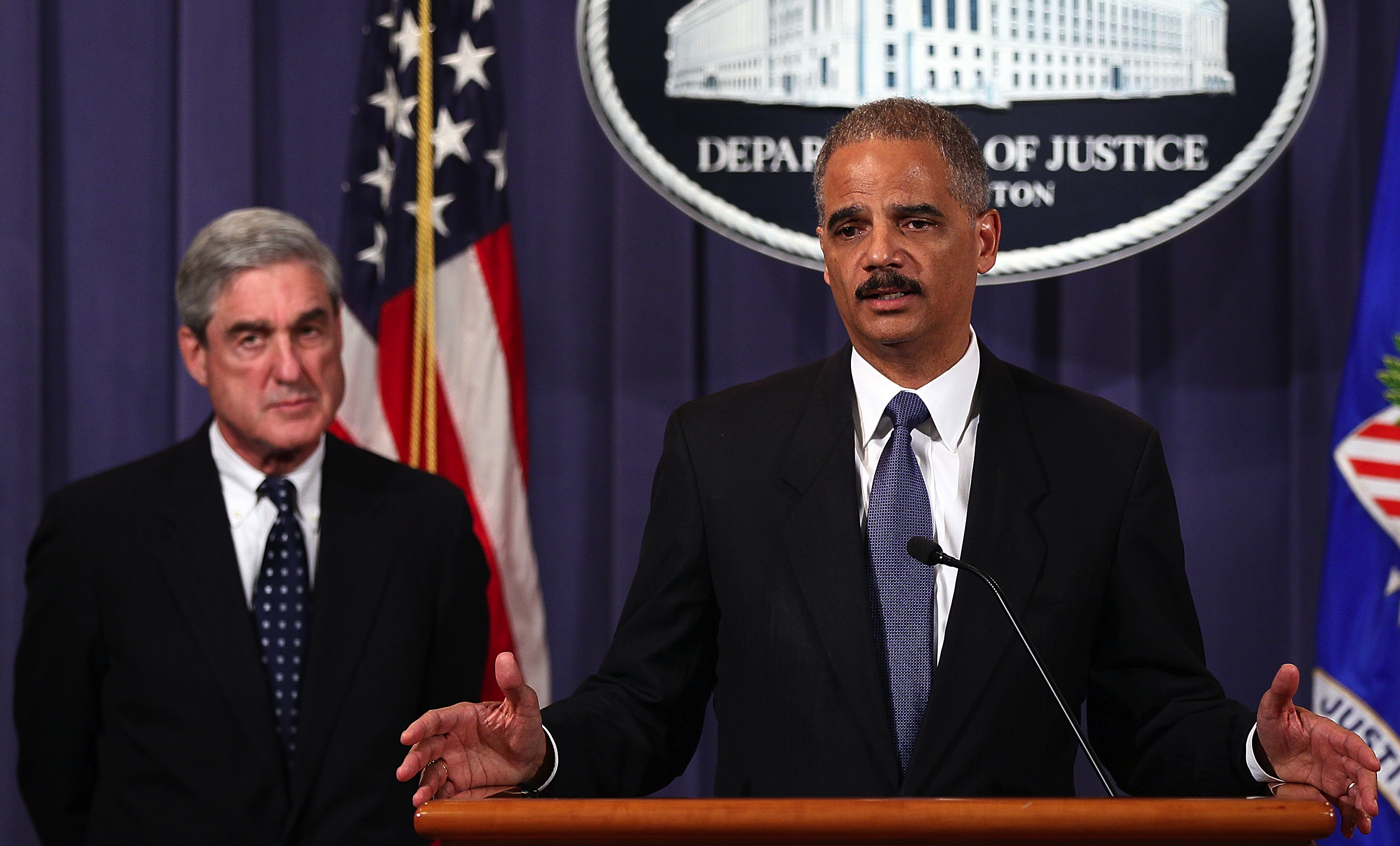 """The Department of Justice has asked a Manhattan judge to grant its """"petition to enforce"""" a warrantless legal demand the FBI sent Google. FBI director Robert Mueller and attorney general Eric Holder, right, in this file photograph."""