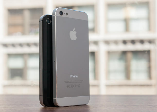 The iPhone 4S (left) next to the iPhone 5.