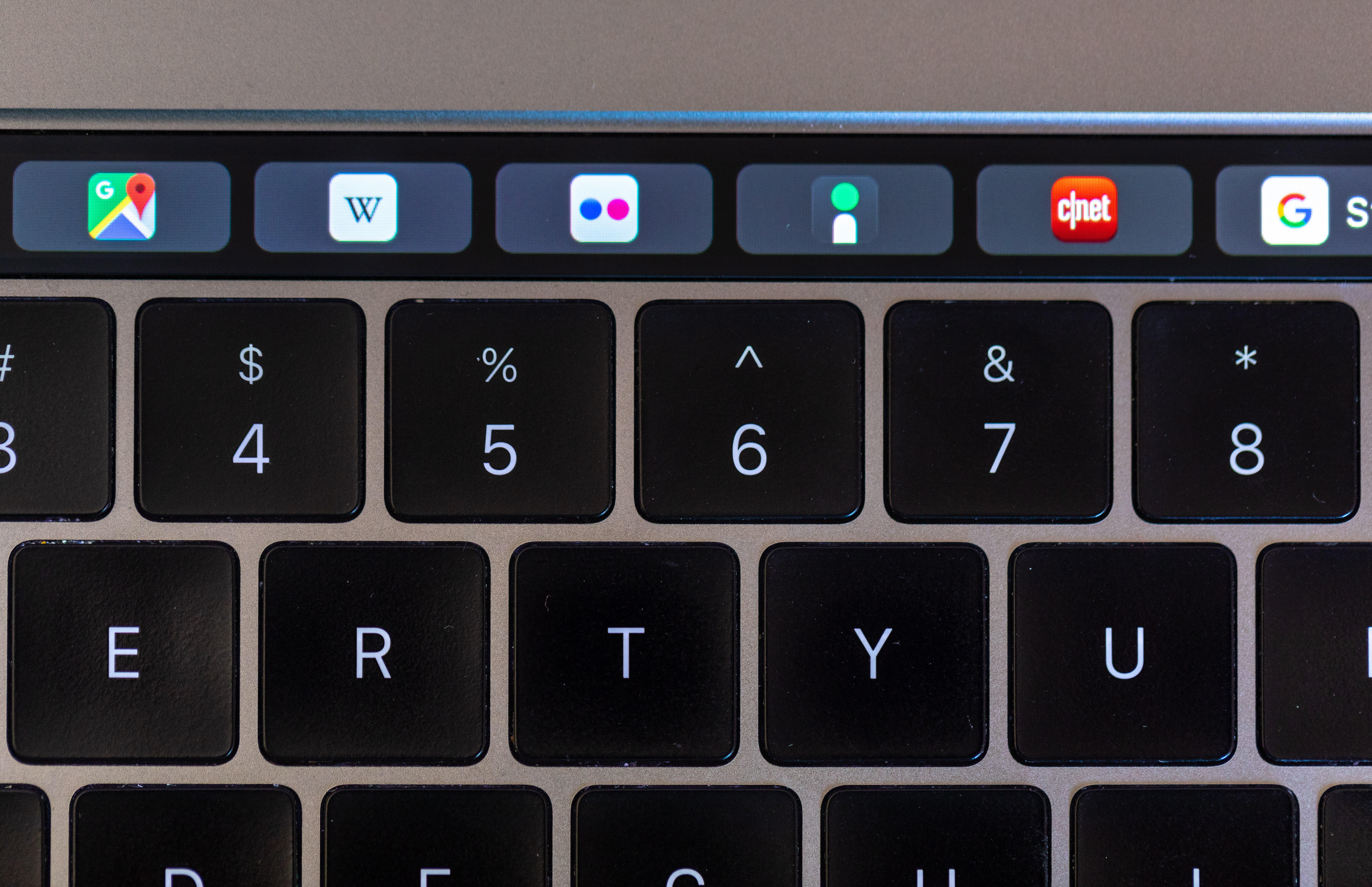 Apple has shunned website favicons on Safari, but they show on MacBook Pro Touch Bar when opening a new tab in Safari.