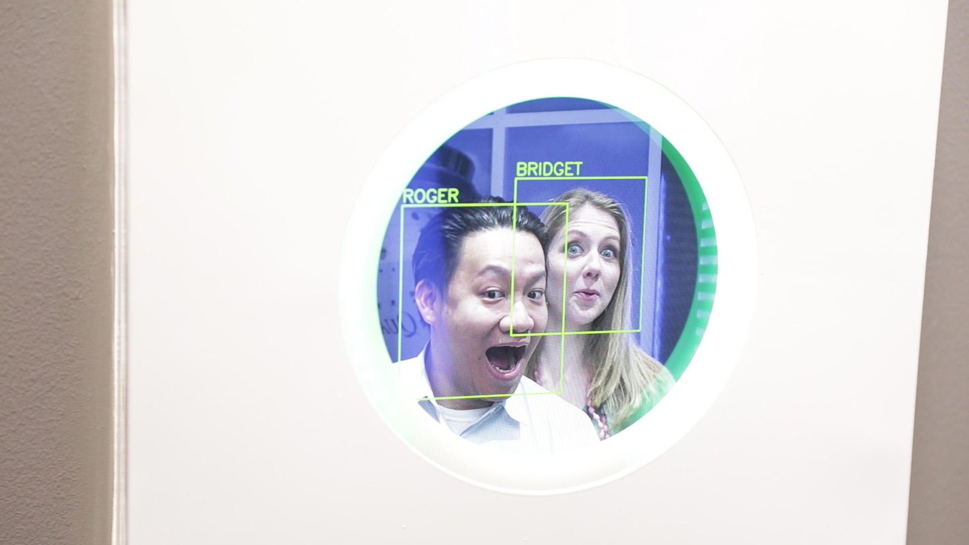 Roger Cheng and Bridget Carey test a facial recognition system.