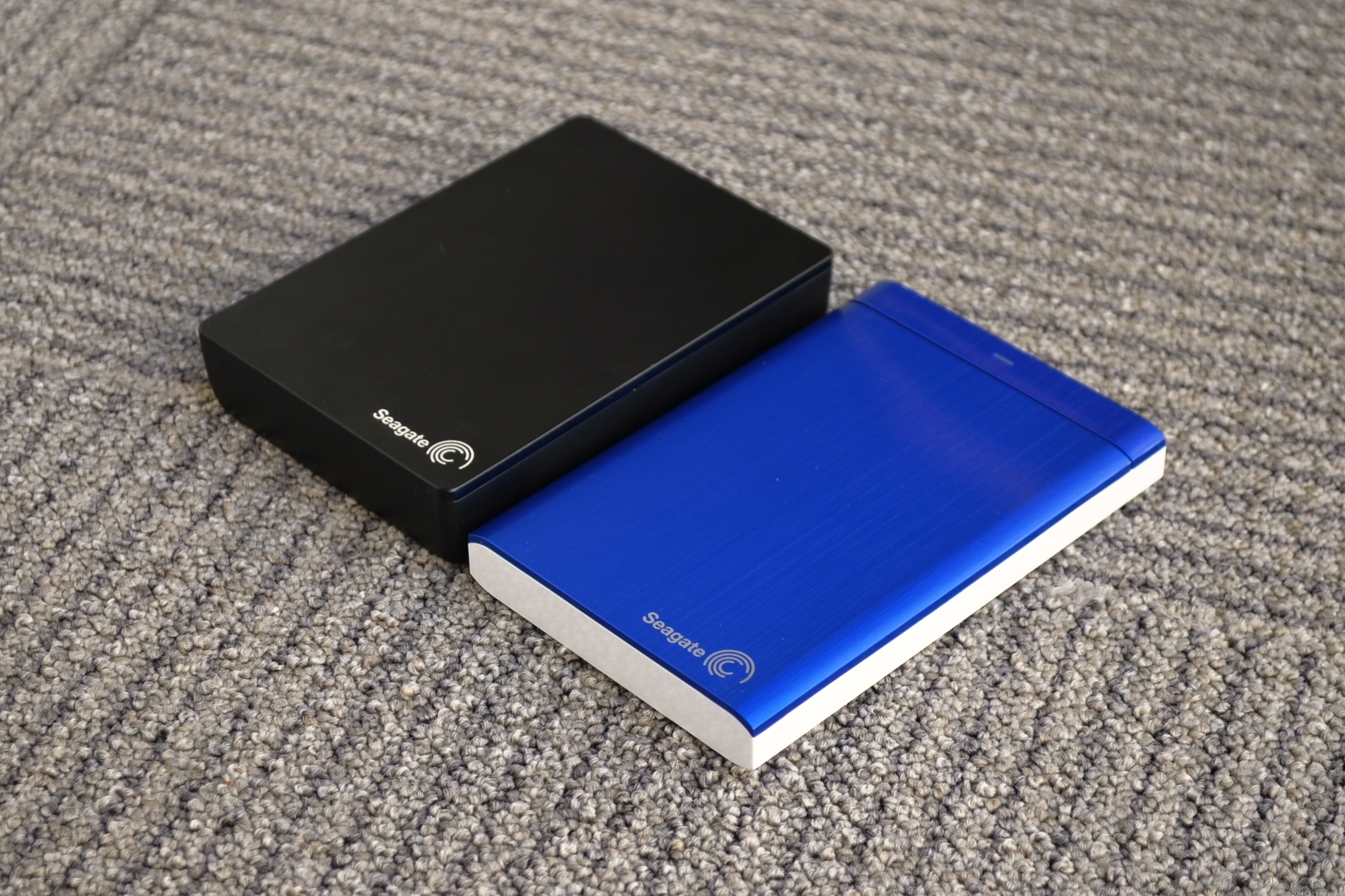 The new Backup Plus Fast (left) is much thicker than the original Backup Plus drive.