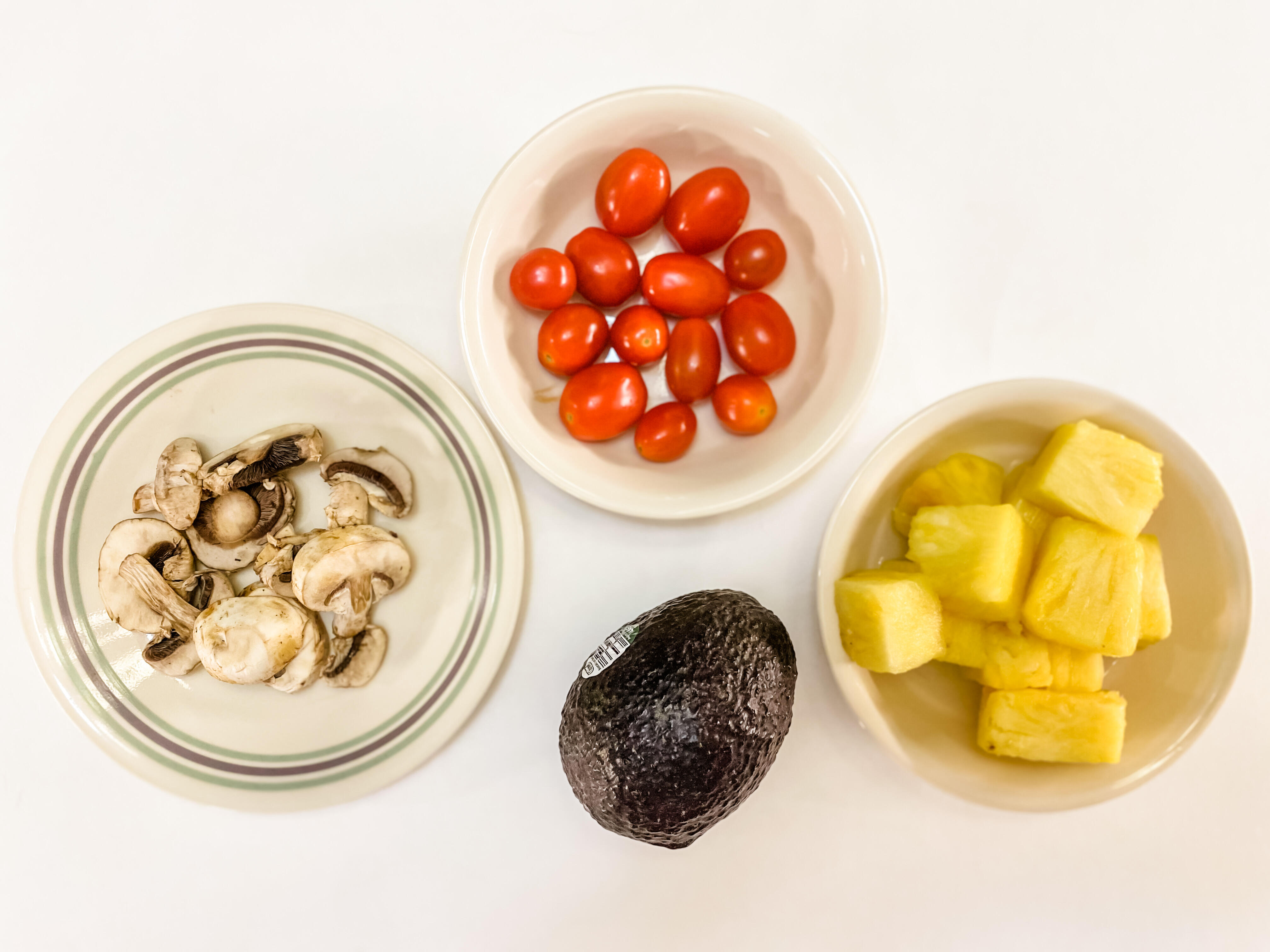5 servings of produce: half a cup of mushrooms, half a cup of cherry tomatoes, a cup of pineapple, an avocado