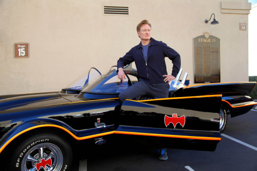 When you're comedian and late night talk show host Conan O'Brien, you get to break news about Batman AND borrow his car.