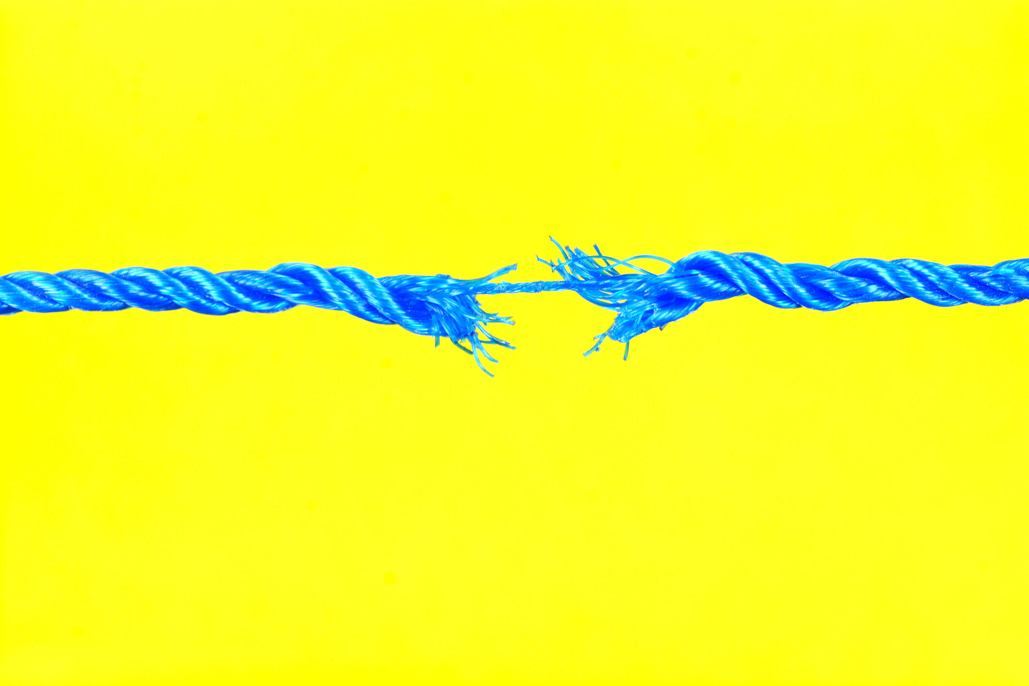 bright yellow background with a blue frayed rope at the forefront
