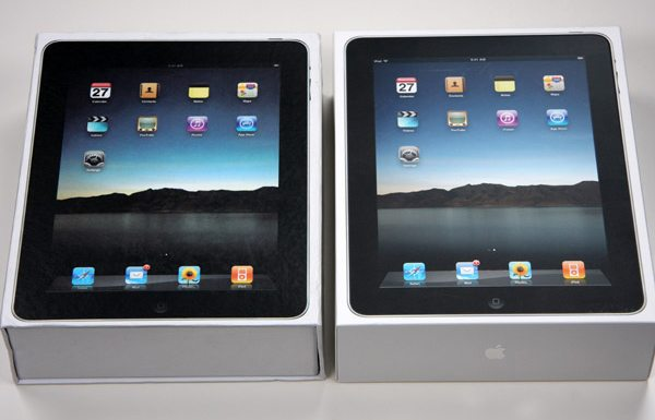 A counterfeit iPad next to the real deal.