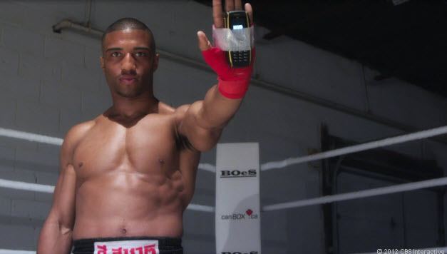 MMA fighter Simon Marcus throws punches with a Sonim Bolt rugged phone.