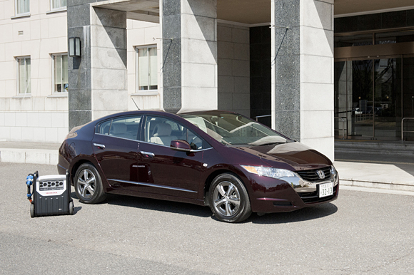 The Honda FCX clarity with a mobile power supply system.