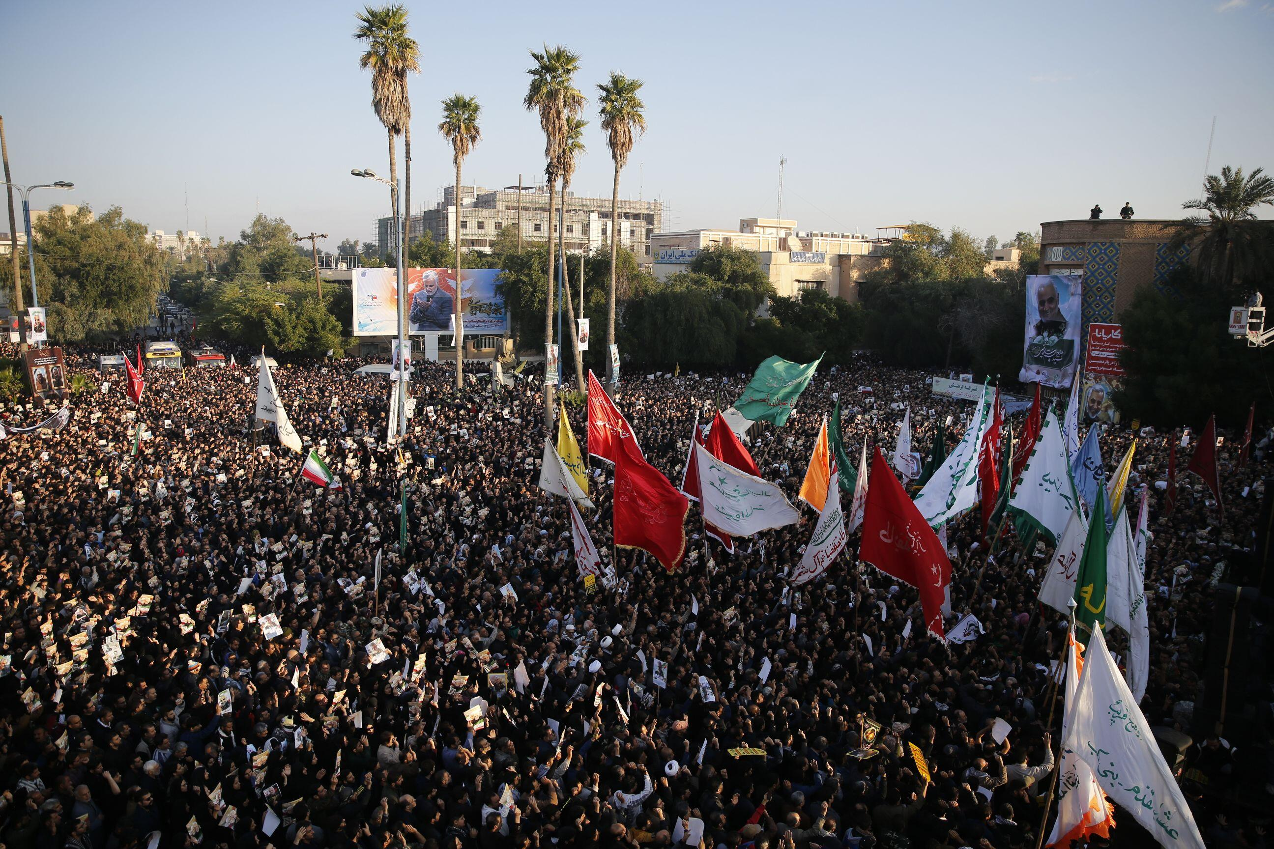 Iranians march in the streets to pay homage to General Qasem Soleimani