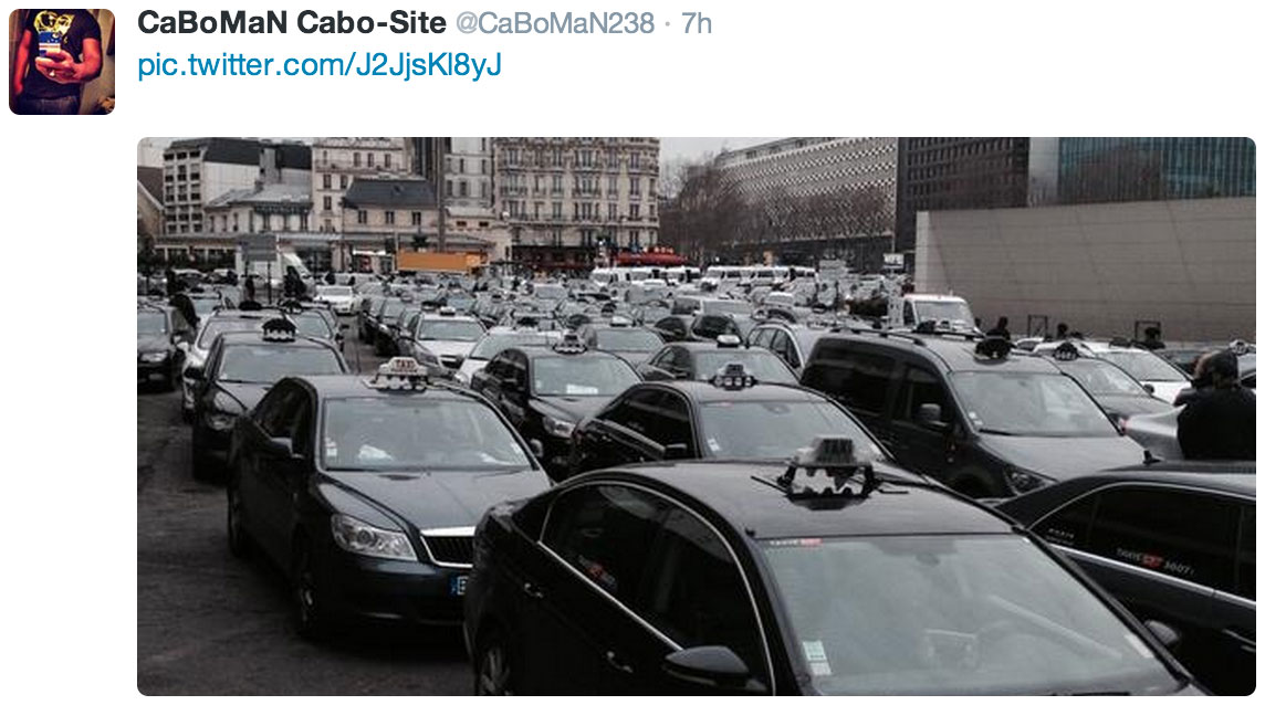 """Taxis protesting """"VTC"""" car services like Uber or AlloCab.com blocked traffic in Paris."""
