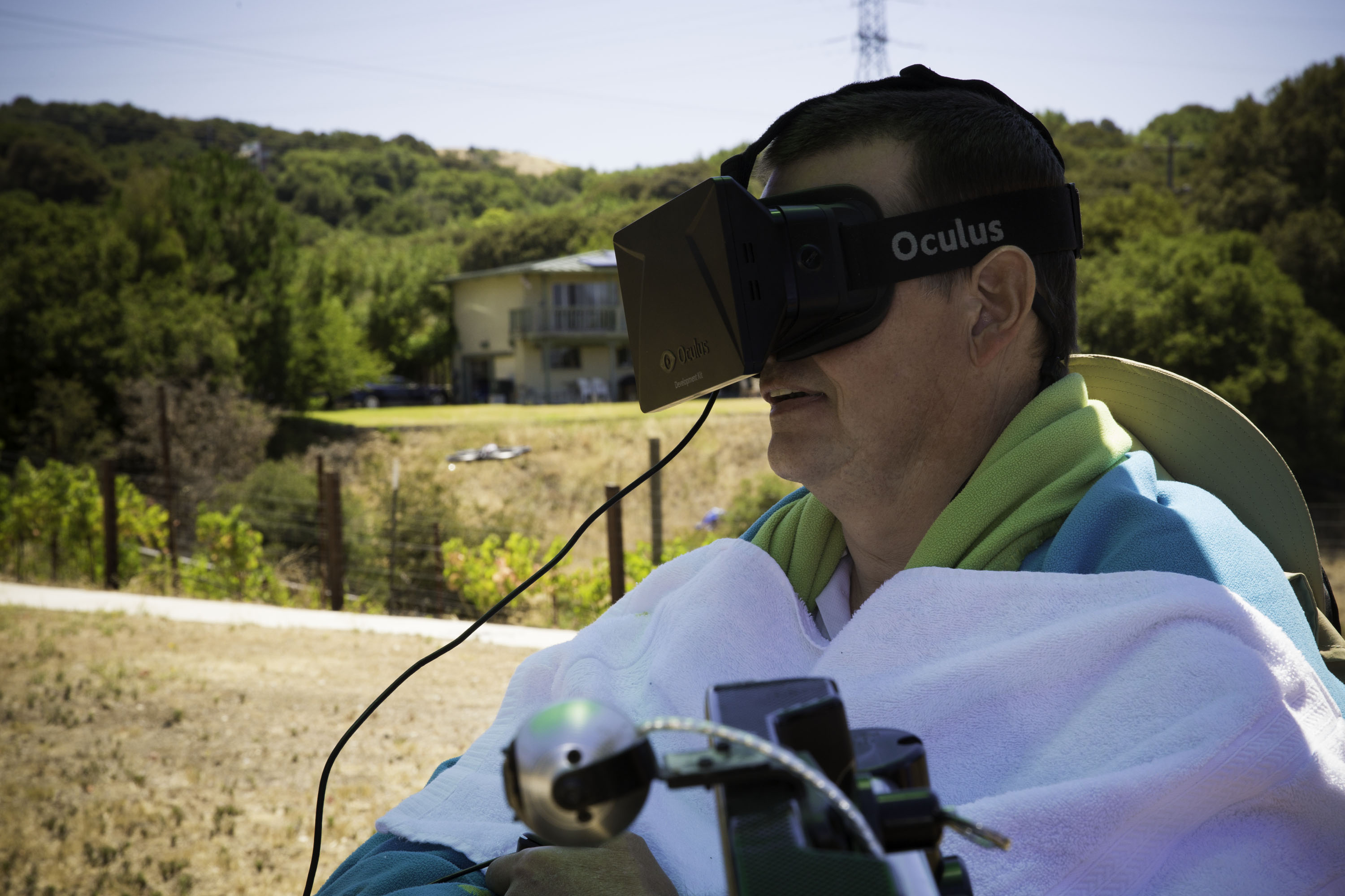 Henry Evans uses an Oculus Rift reality headset to control a camera-equipped drone to let him move virtually through the real world. Eye-tracking technology steers the drone.