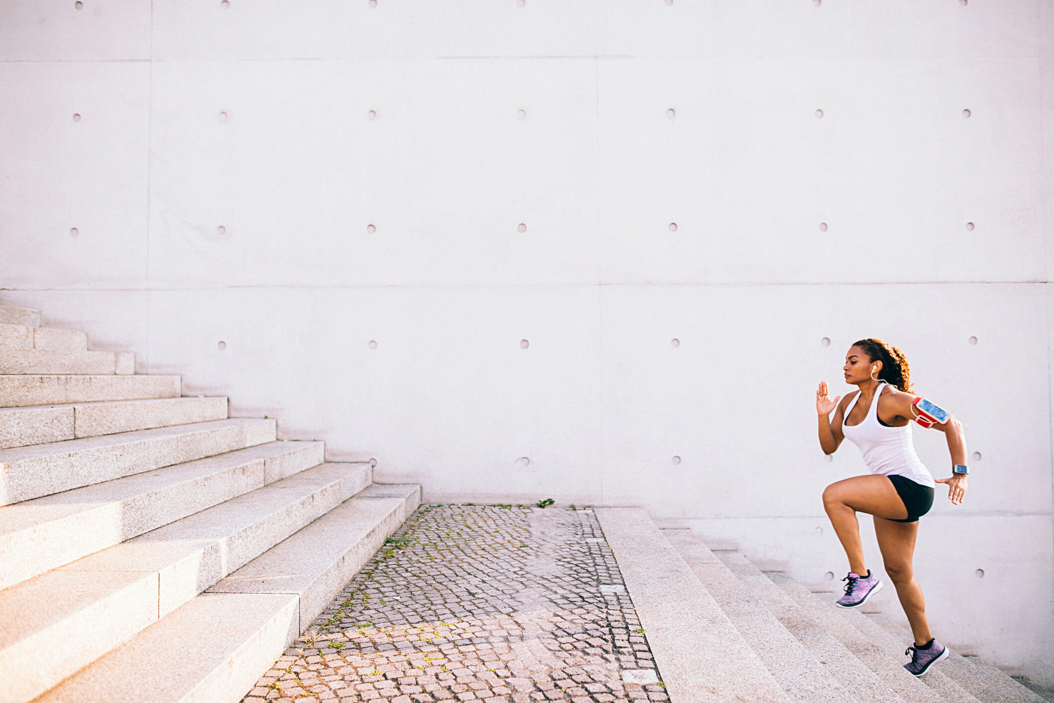 woman running stairs outside