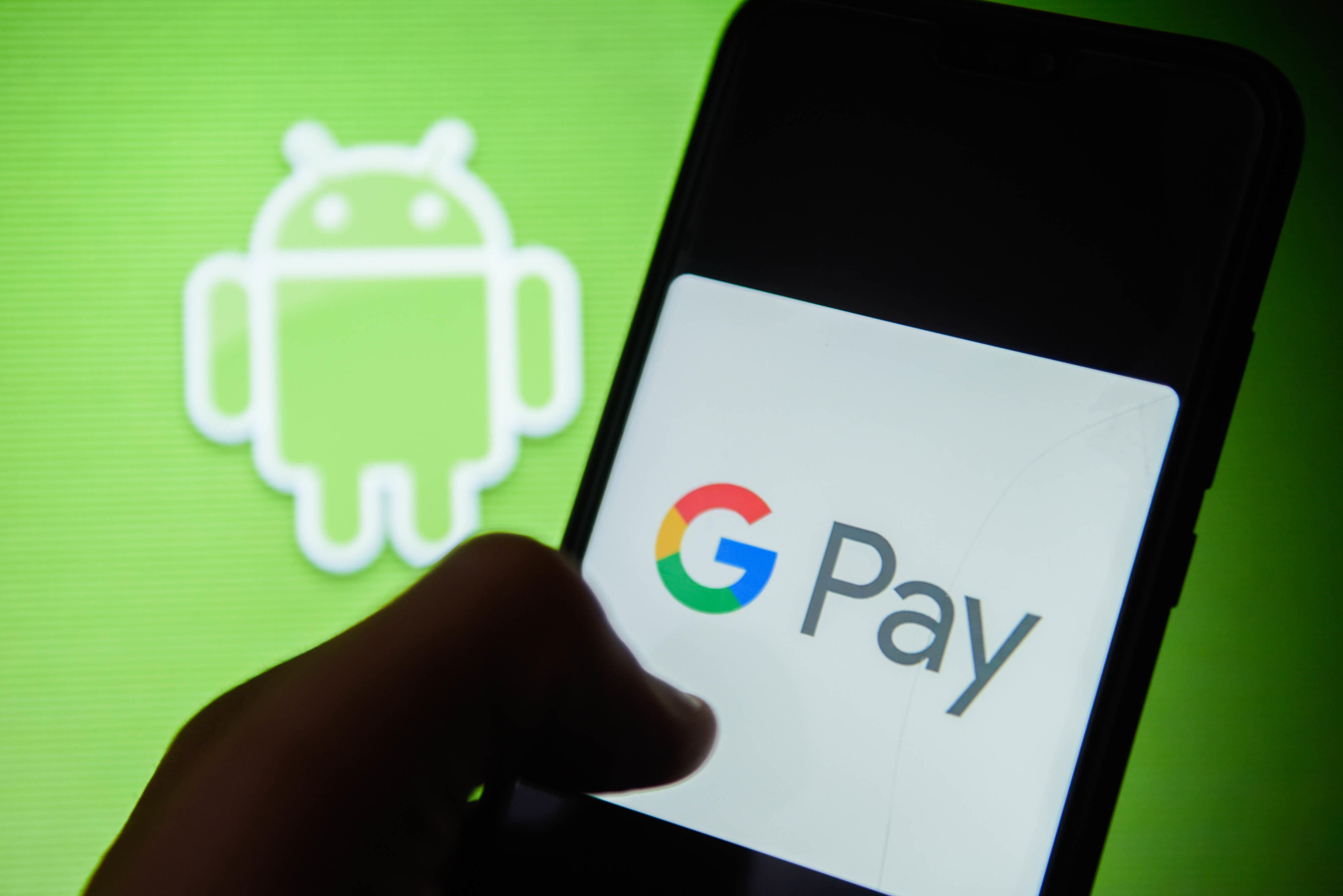 Google Pay logo is seen on an android mobile phone