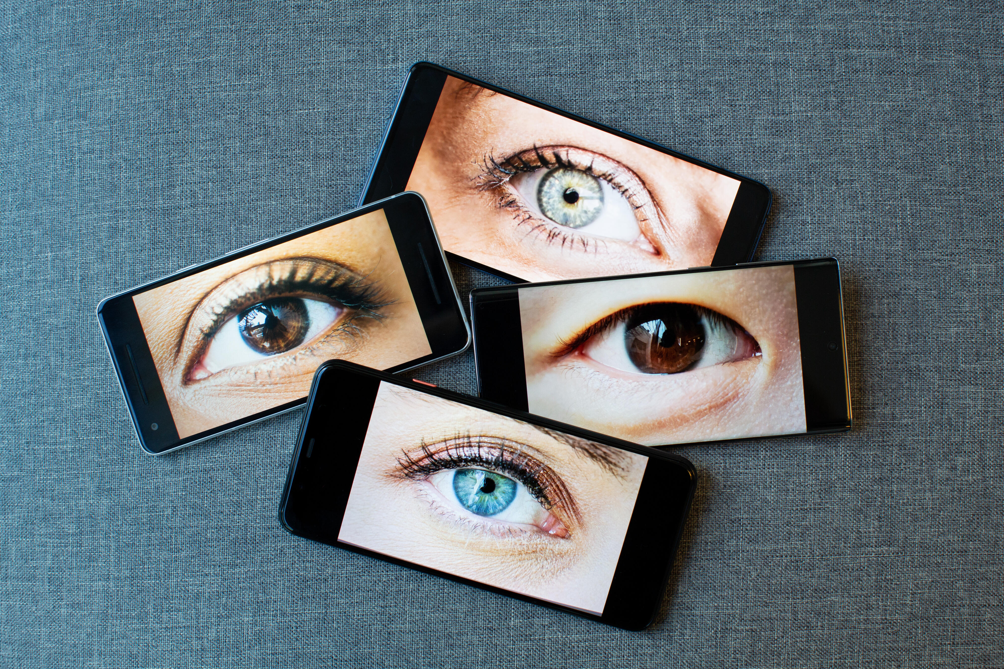 Illustration with phones featuring eyes on their screens