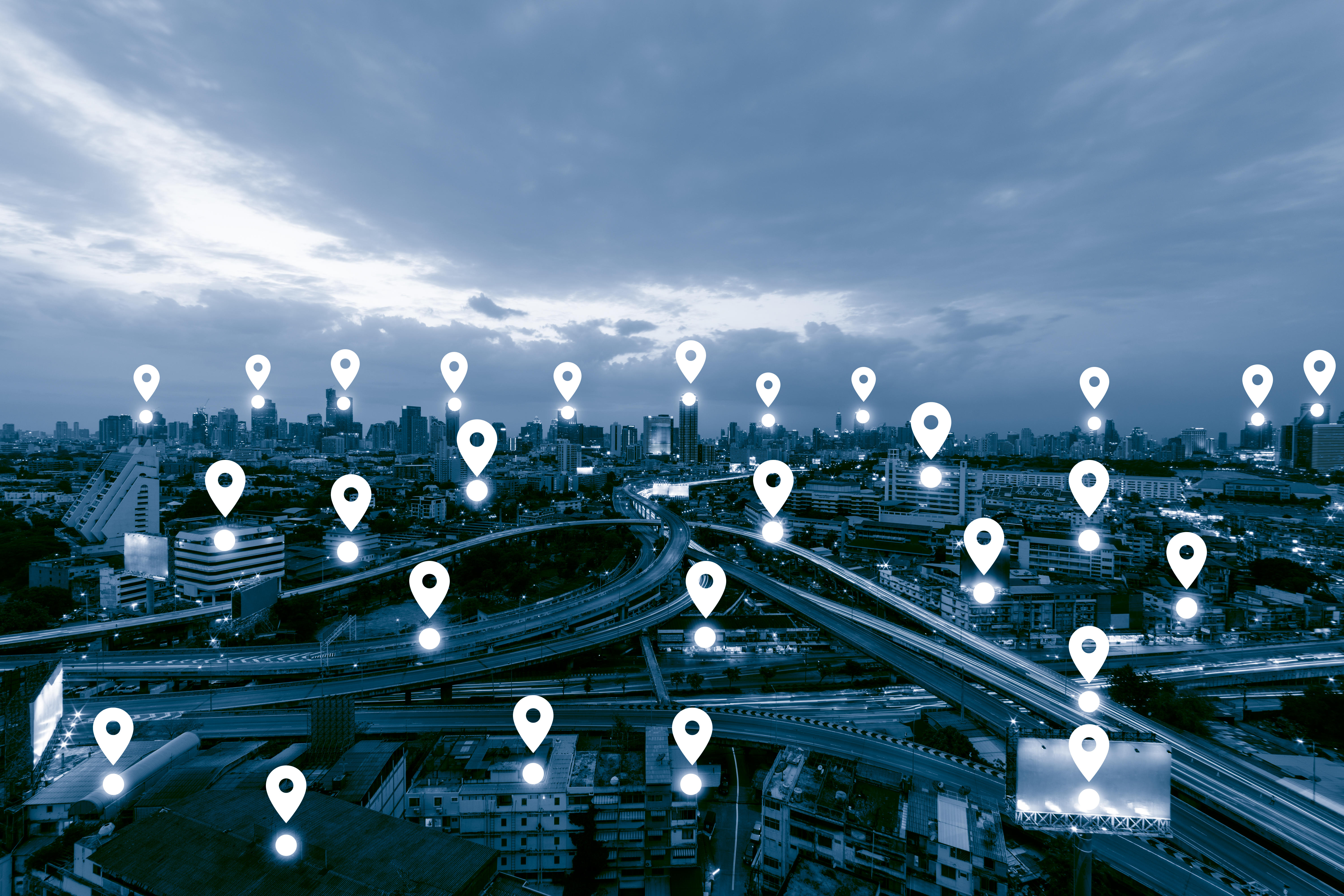 Blue tone city scape and network connection concept , Map pin business district