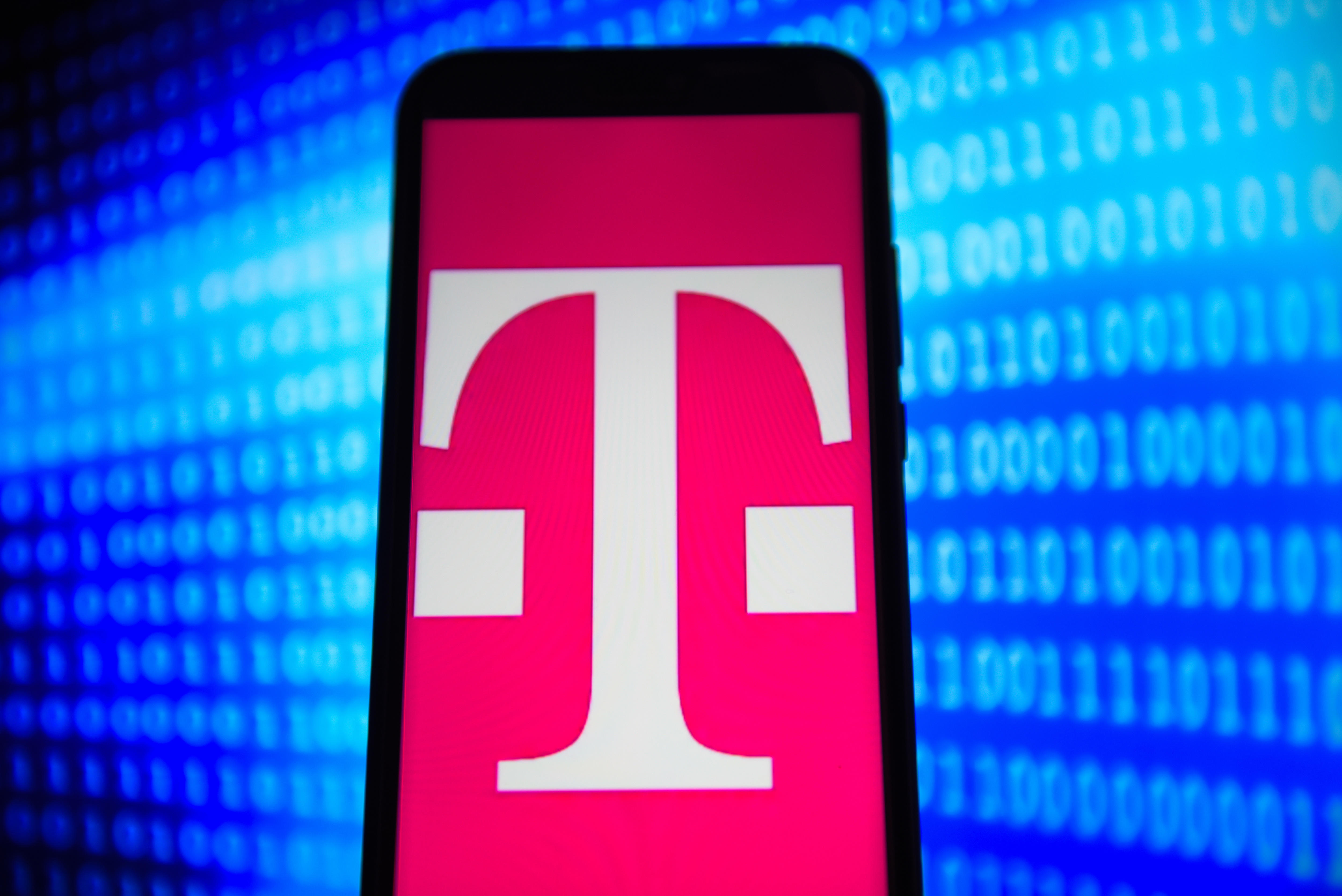T mobile logo is seen on an android mobile phone