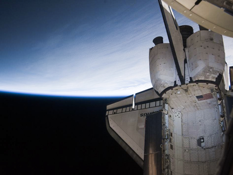 Orbiting at an altitude of about 250 miles, space shuttle Atlantis' aft section is visible against the blue of Earth while it docks with the International Space Station during the STS-132 mission.