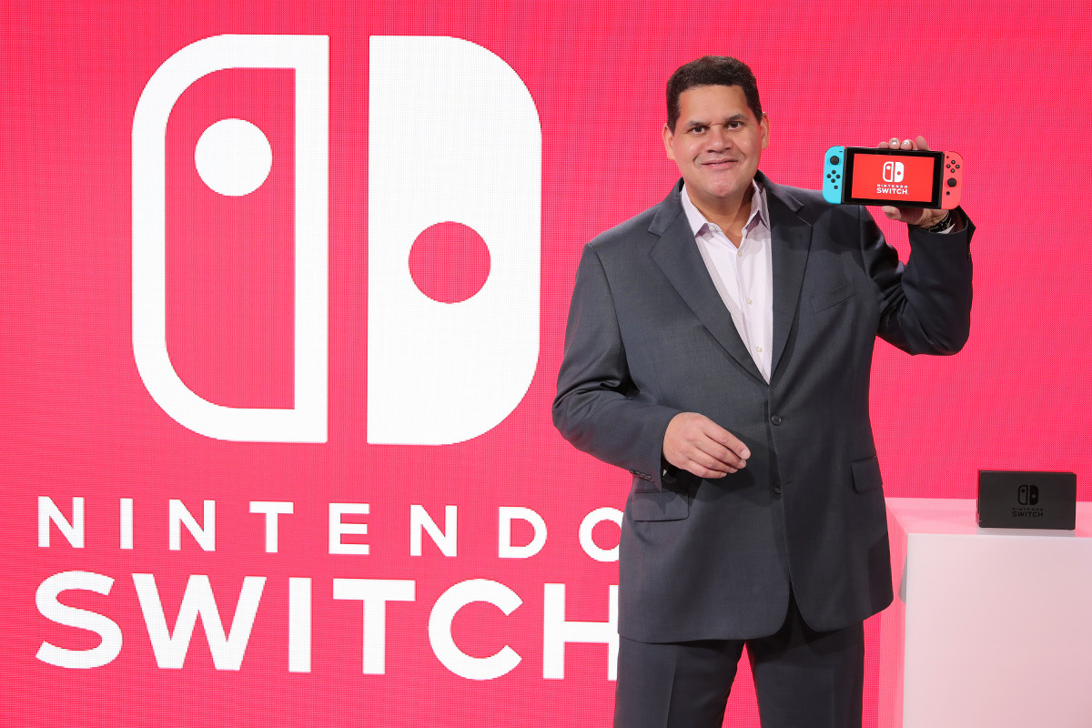 Nintendo of America President Reggie Fils-Aime. That Switch held in his hand is not actually a handheld. Not primarily anyway, he tells us.
