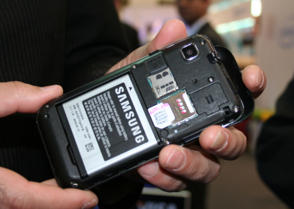 The microSD memory card fits in to a slot in the back of the phone. In the iPhone it fits into a slot in a special skin.